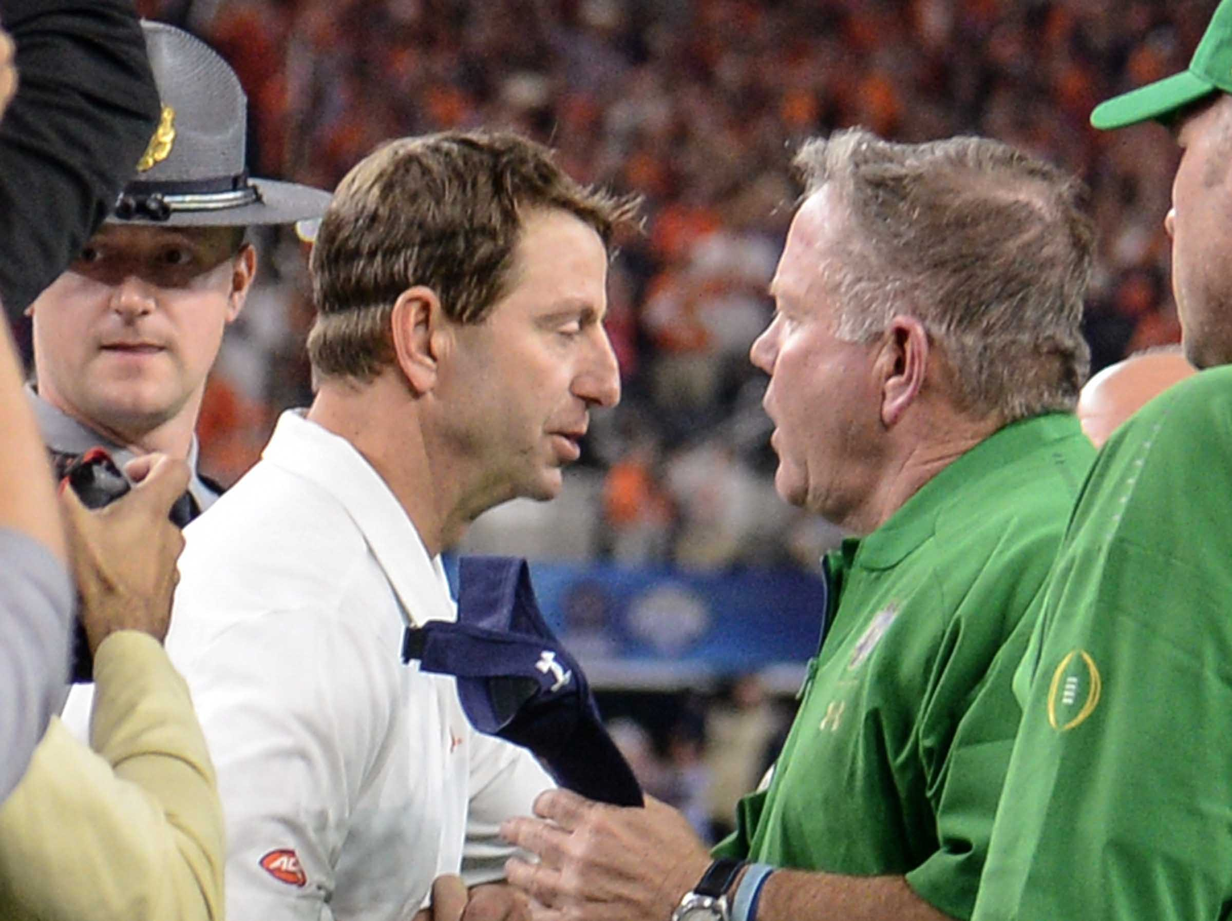 Clemson Head Coach Dabo Swinney and Notre Dame head coach Brian Kelly shake hands after the College Football Playoff Semifinal 30-3 win over Notre Dame at the Goodyear Cotton Bowl Classic at AT&T Stadium in Arlington, Texas Saturday, December 29, 2018.