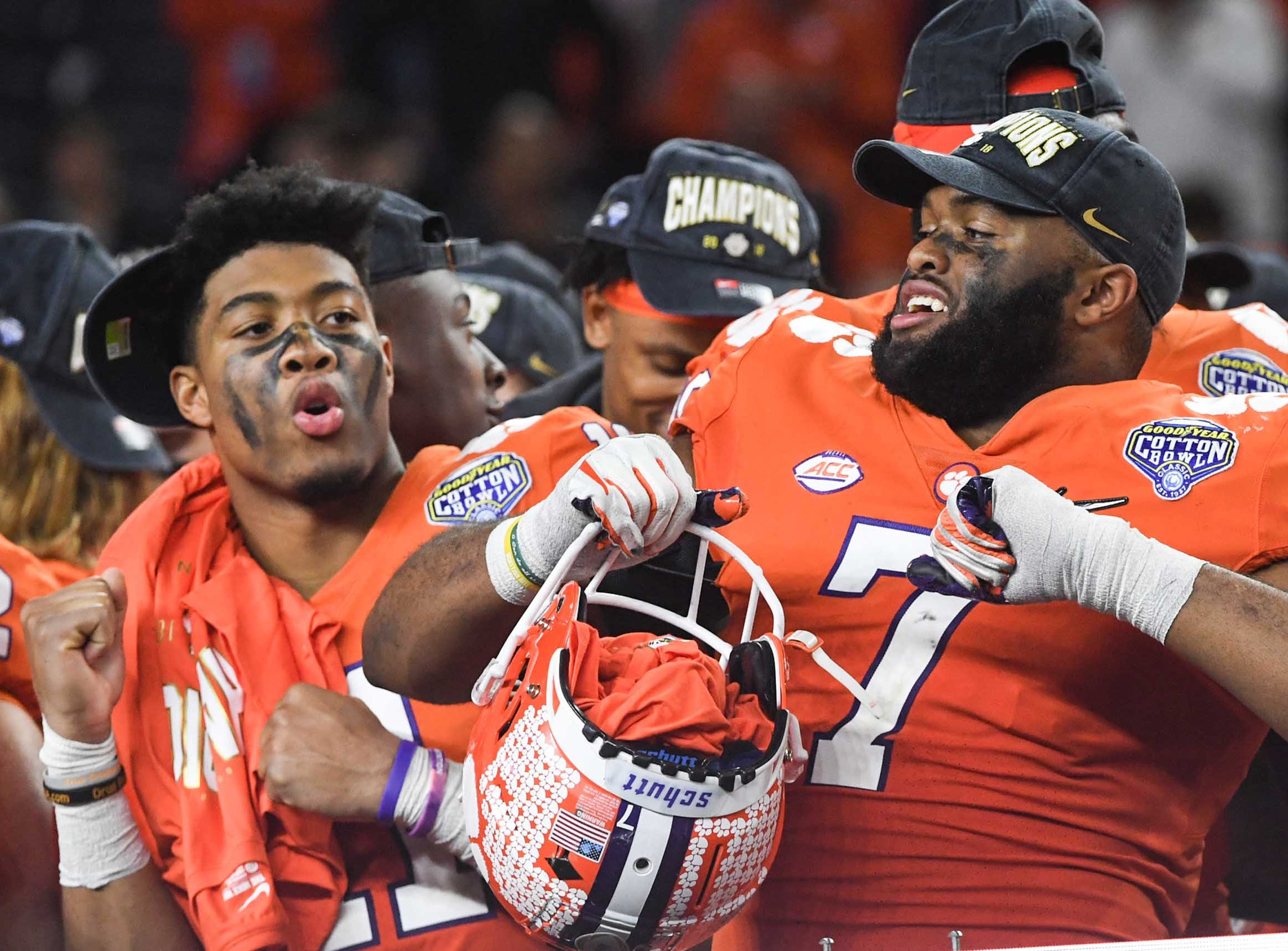 Clemson safety Isaiah Simmons (11), left, and defensive lineman Austin Bryant (7) celebrate on the post game stage after the College Football Playoff Semifinal 30-3 win over Notre Dame at the Goodyear Cotton Bowl Classic at AT&T Stadium in Arlington, Texas Saturday, December 29, 2018.