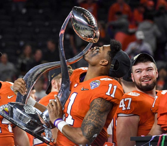 Clemson safety Isaiah Simmons (11) kisses the trophy after the College Football Playoff Semifinal 30-3 win over Notre Dame at the Goodyear Cotton Bowl Classic at AT&T Stadium in Arlington, Texas Saturday, December 29, 2018.