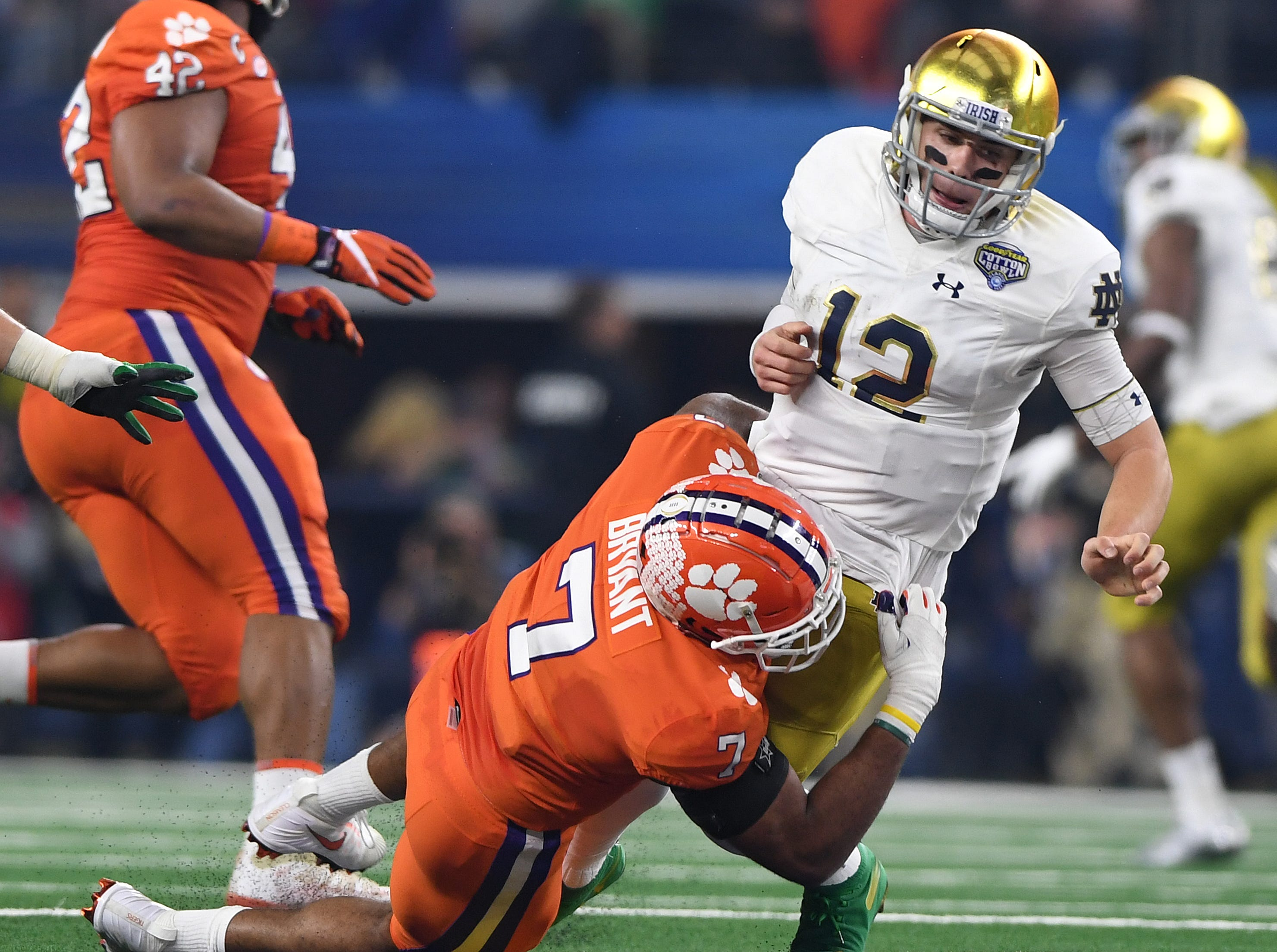 Clemson defensive lineman Austin Bryant (7) brings down Notre Dame quarterback Ian Book (12) during the 2nd quarter of the Goodyear Cotton Bowl at AT&T stadium in Arlington, TX Saturday, December 29, 2018.
