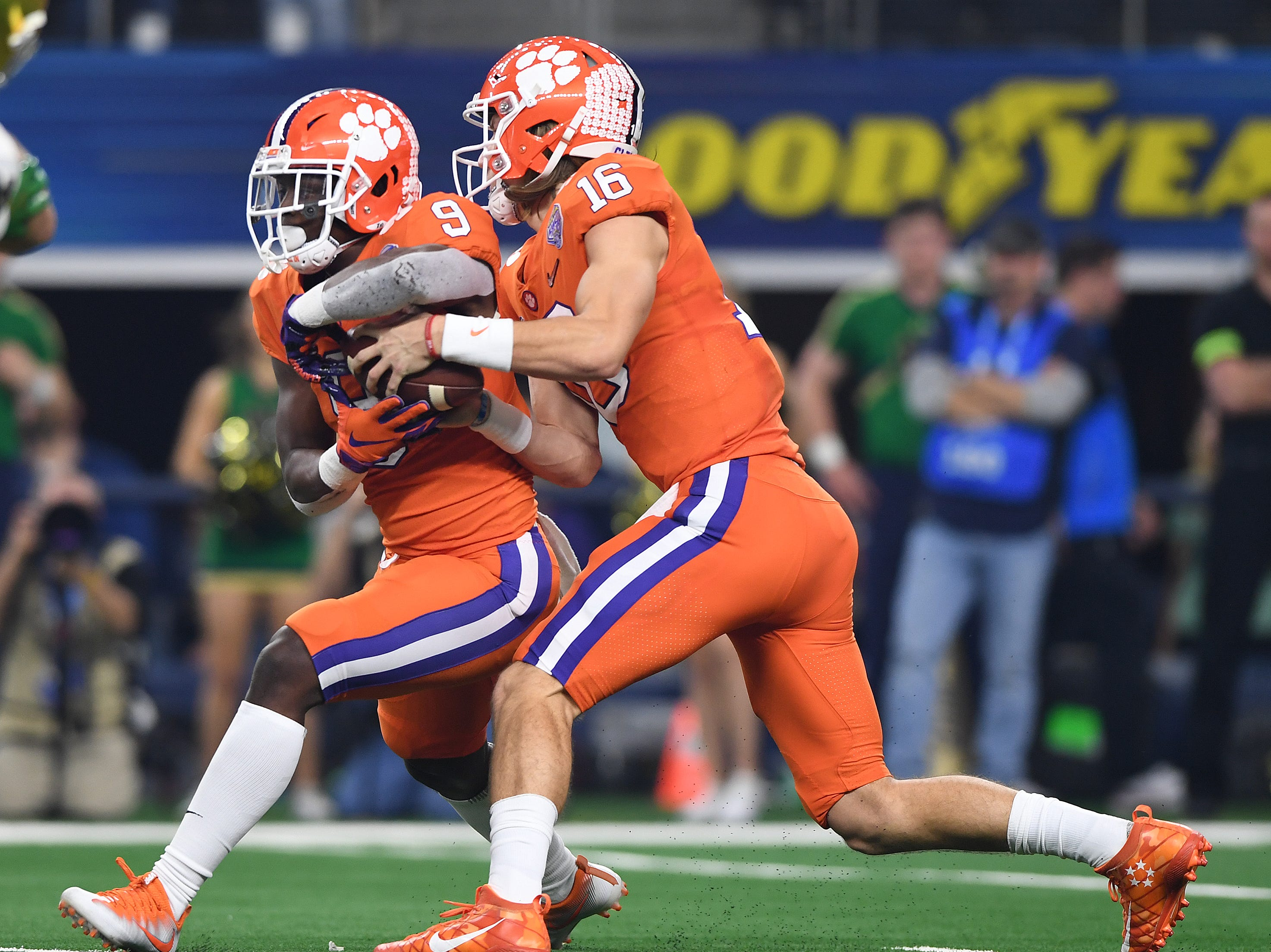 Clemson quarterback Trevor Lawrence (16) pulls the ball from running back Travis Etienne (9) while playing Notre Dame during the 1st quarter of the Goodyear Cotton Bowl at AT&T stadium in Arlington, TX Saturday, December 29, 2018.