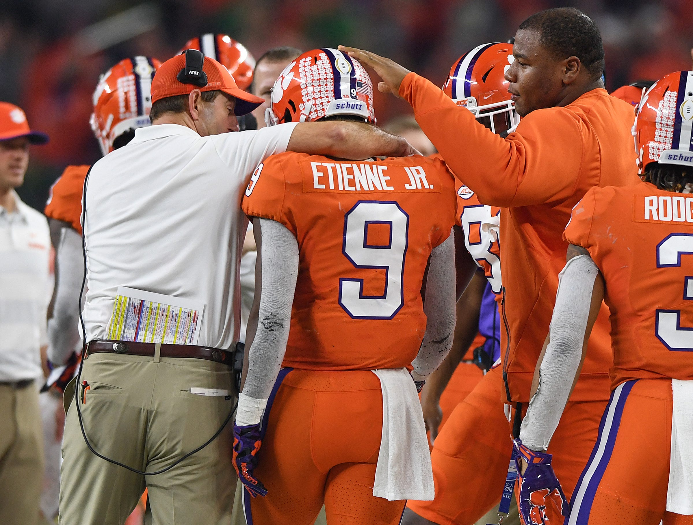 Clemson head coach Dabo Swinney congratulates running back Travis Etienne (9) after he scored on a 62 yard carry against Notre Dame during the 3rd quarter of the Goodyear Cotton Bowl at AT&T stadium in Arlington, TX Saturday, December 29, 2018.