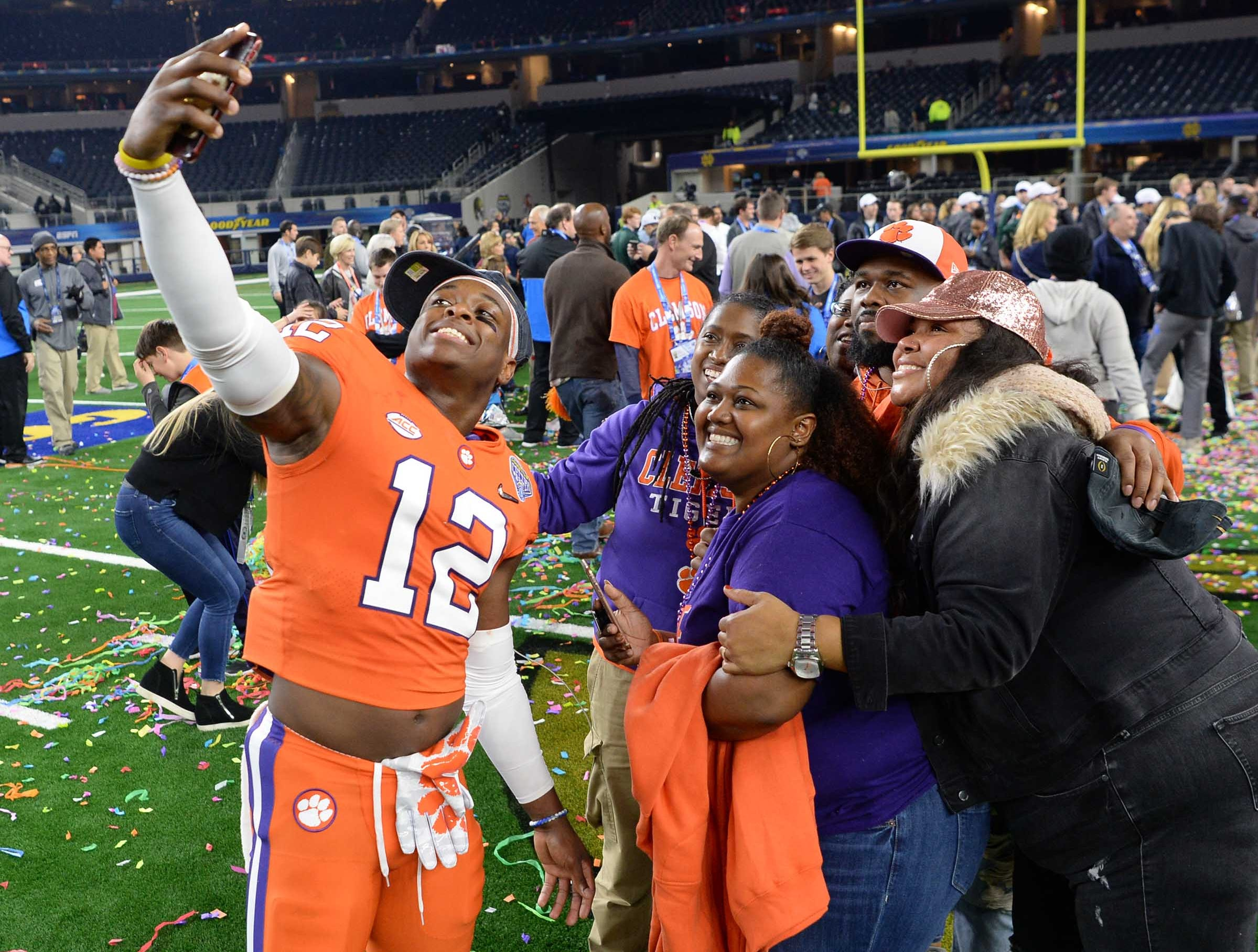 Clemson defensive back K'Von Wallace (12) poses with family after the College Football Playoff Semifinal 30-3 win over Notre Dame at the Goodyear Cotton Bowl Classic at AT&T Stadium in Arlington, Texas Saturday, December 29, 2018.