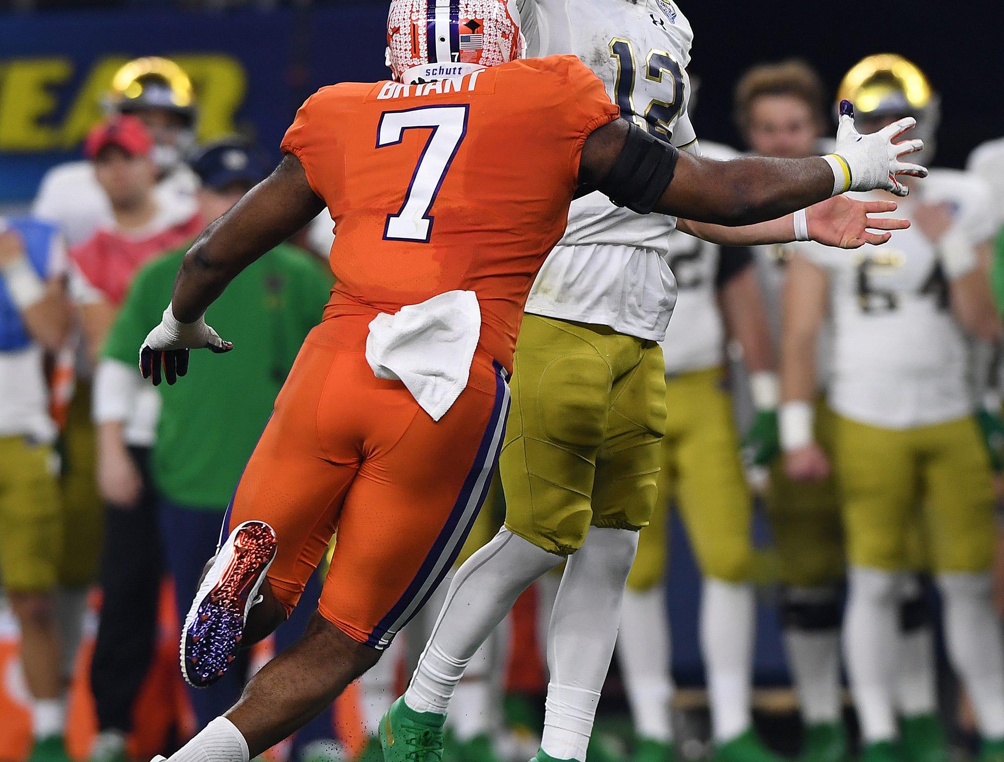 Clemson defensive lineman Austin Bryant (7) pressures Notre Dame quarterback Ian Book (12) during the 3rd quarter of the Goodyear Cotton Bowl at AT&T stadium in Arlington, TX Saturday, December 29, 2018.