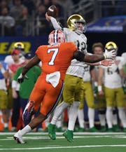 Clemson defensive lineman Austin Bryant (7) pressures Notre Dame quarterback Ian Book (12) during the 3rd quarter of the Goodyear Cotton Bowl at AT&T stadium in Arlington, TX Saturday, December 29, 2018.