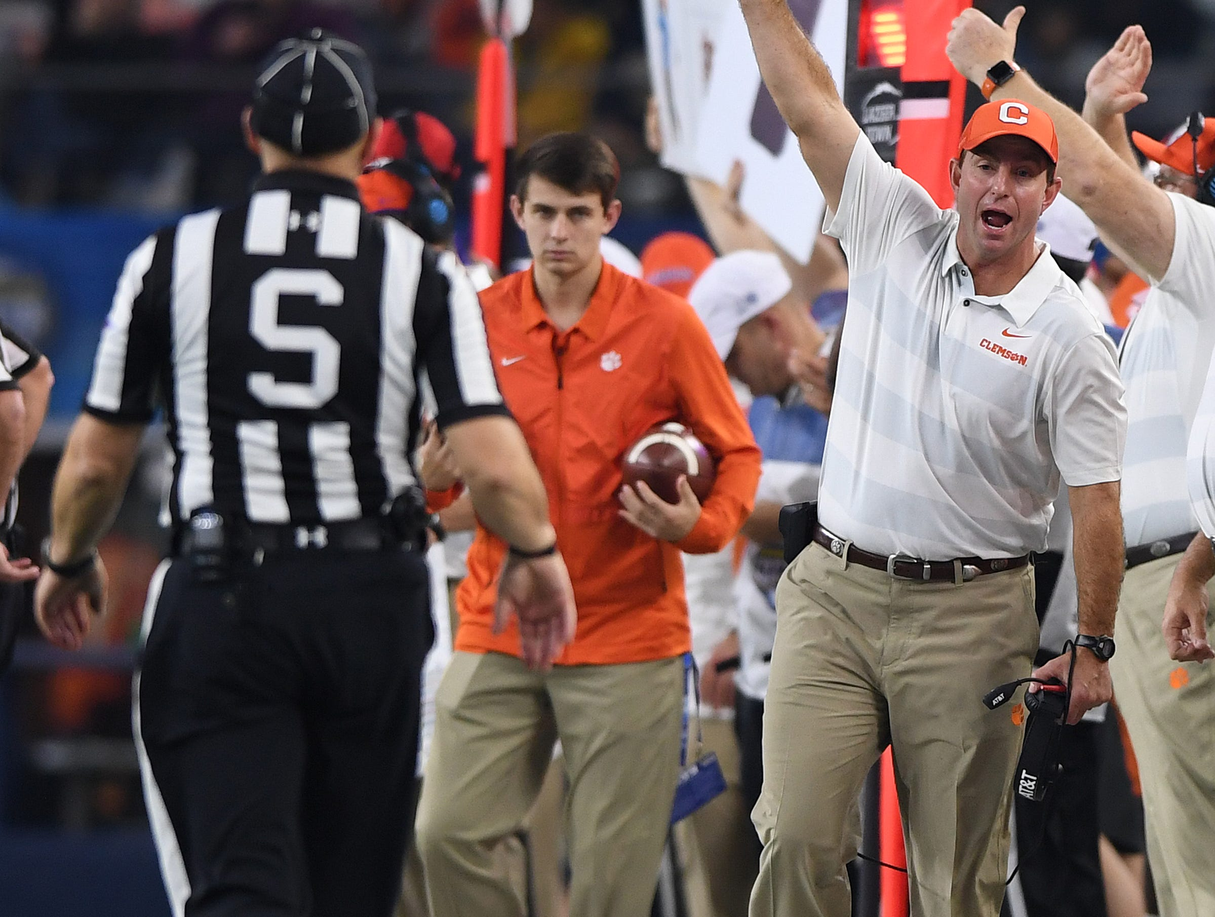 Clemson head coach Dabo Swinney argues a non call with an official during the 3rd quarter of the Goodyear Cotton Bowl at AT&T stadium in Arlington, TX Saturday, December 29, 2018.