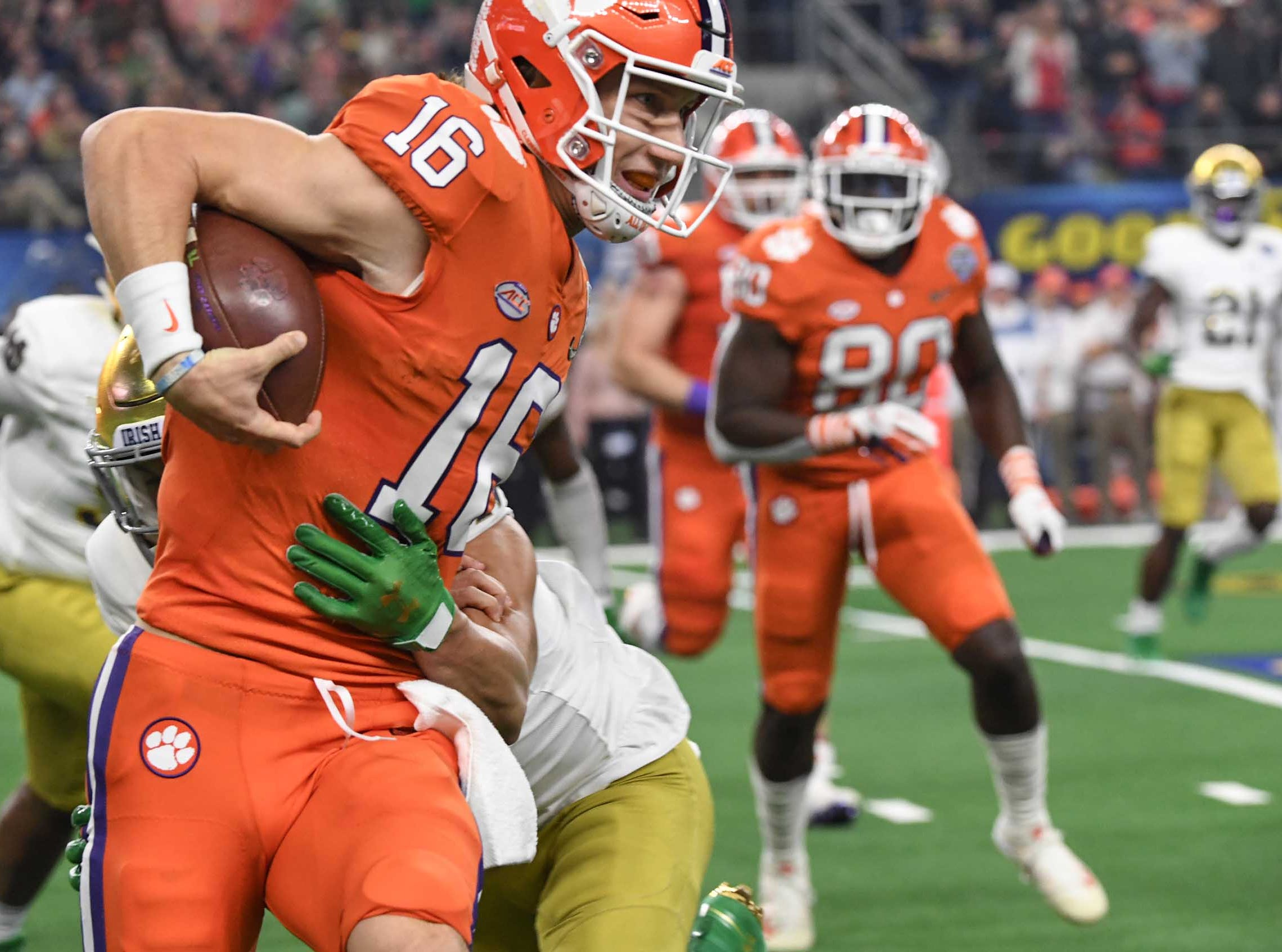 Clemson quarterback Trevor Lawrence (16) runs against Notre Dame during the third quarter of the College Football Playoff Semifinal at the Goodyear Cotton Bowl Classic at AT&T Stadium in Arlington, Texas Saturday, December 29, 2018.