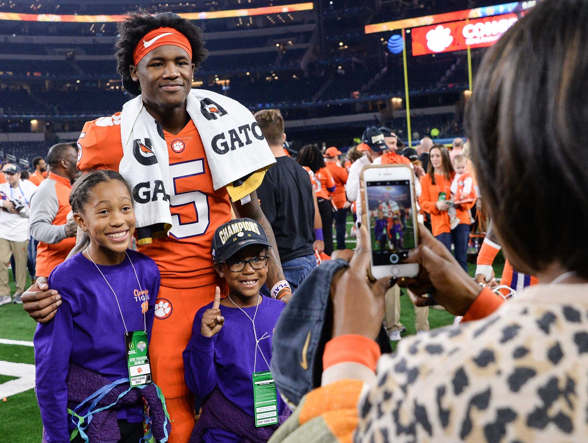 Clemson wide receiver Tee Higgins (5) poses after the Tigers beat Notre Dame 30-3 in the College Football Playoff Semifinal at the Goodyear Cotton Bowl Classic at AT&T Stadium in Arlington, Texas Saturday, December 29, 2018.