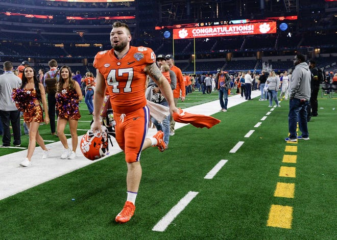 Clemson linebacker James Skalski (47) runs off the field to the locker room after the Tigers beat Notre Dame 30-3 in the College Football Playoff Semifinal at the Goodyear Cotton Bowl Classic at AT&T Stadium in Arlington, Texas Saturday, December 29, 2018.
