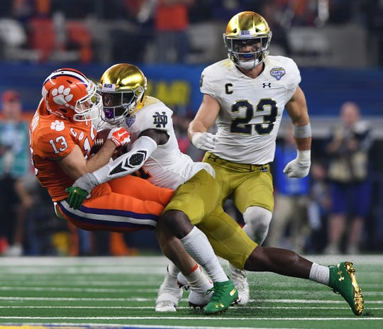 Clemson wide receiver Hunter Renfrow (13) is brought down by Notre Dame linebacker Jack Lamb (31) after catching a pass against Notre Dame during the 2nd quarter of the Goodyear Cotton Bowl at AT&T stadium in Arlington, TX Saturday, December 29, 2018.