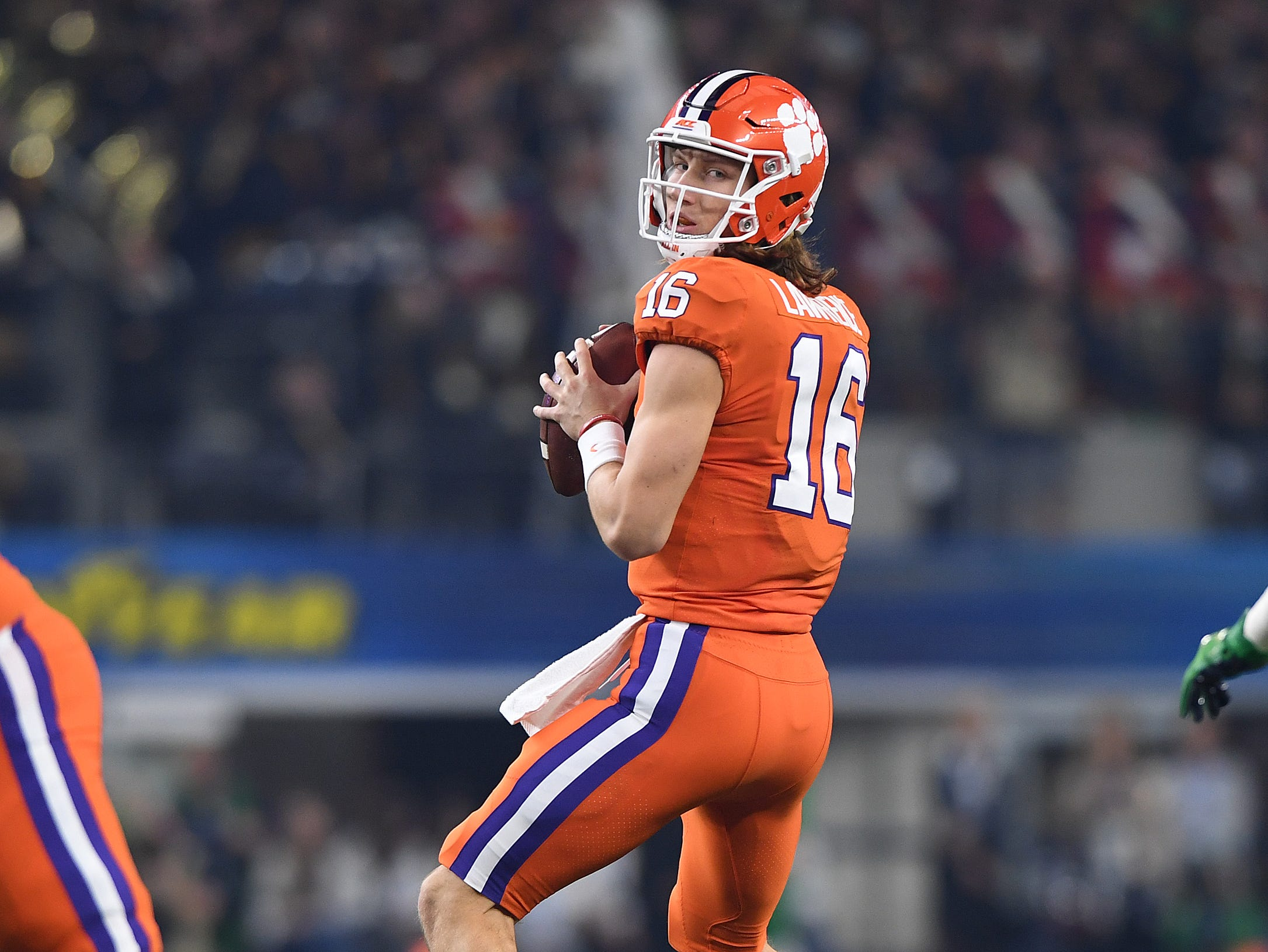 Clemson quarterback Trevor Lawrence (16) looks to pass against Notre Dame during the 1st quarter of the Goodyear Cotton Bowl at AT&T stadium in Arlington, TX Saturday, December 29, 2018.