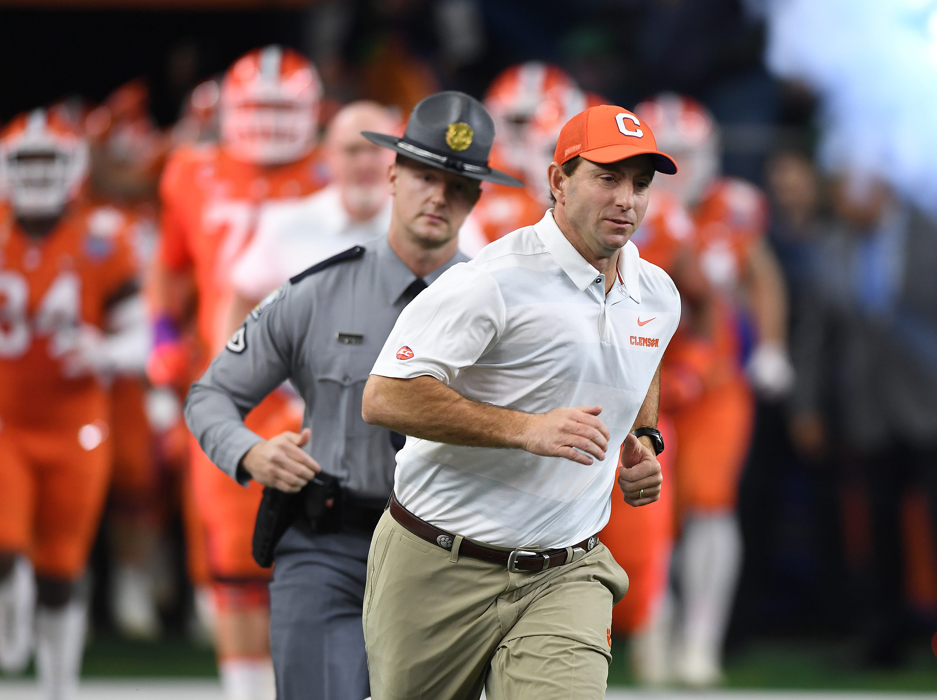 Clemson head coach Dabo Swinney leads his team onto the field during pregame of the Goodyear Cotton Bowl at AT&T stadium in Arlington, TX Saturday, December 29, 2018.