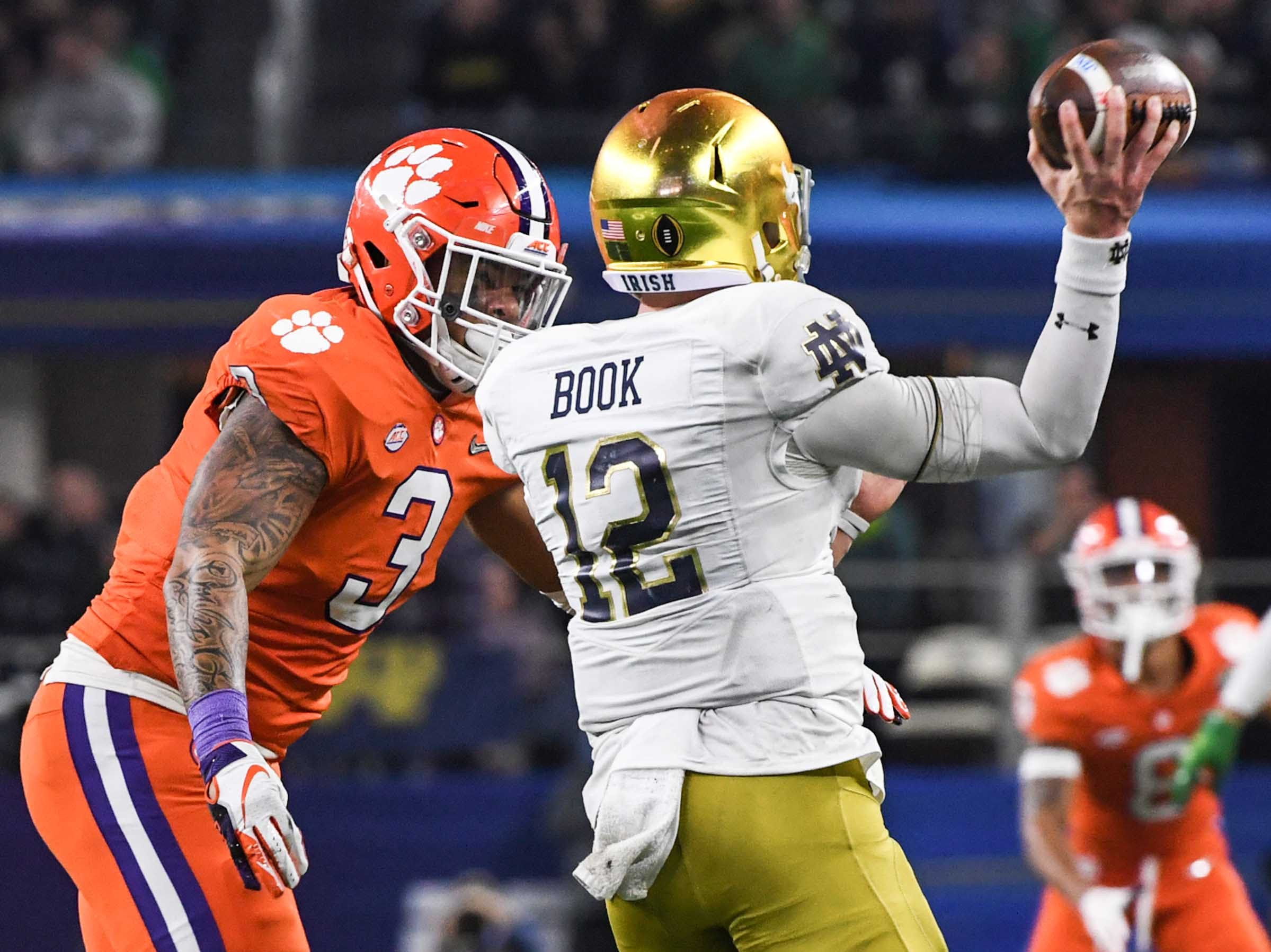Clemson defensive lineman Xavier Thomas (3) pressures Notre Dame quarterback Ian Book (12) during the fourth quarter of the College Football Playoff Semifinal at the Goodyear Cotton Bowl Classic at AT&T Stadium in Arlington, Texas Saturday, December 29, 2018.