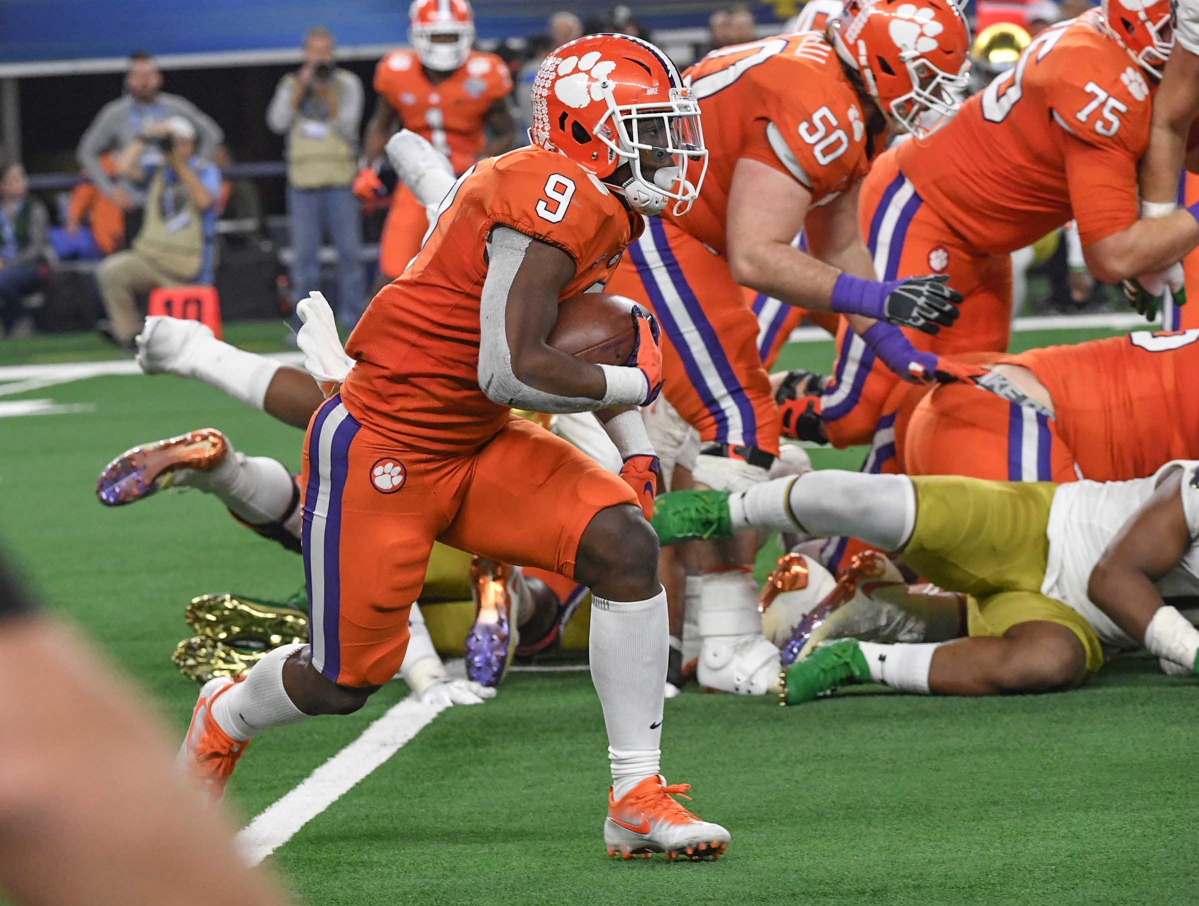 Clemson running back Travis Etienne (9) runs against Notre Dame during the third quarter of the College Football Playoff Semifinal at the Goodyear Cotton Bowl Classic at AT&T Stadium in Arlington, Texas Saturday, December 29, 2018.