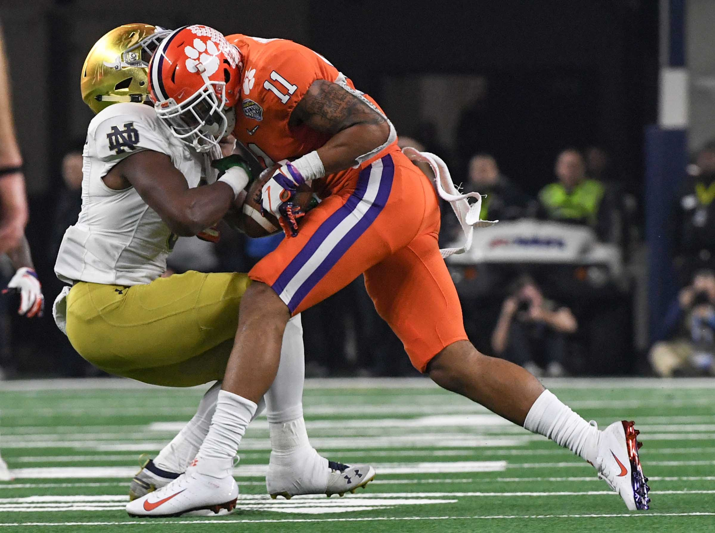 Clemson safety Isaiah Simmons (11) takes the ball out of the hands of Notre Dame running back Jafar Armstrong (8) during the third quarter of the College Football Playoff Semifinal at the Goodyear Cotton Bowl Classic at AT&T Stadium in Arlington, Texas Saturday, December 29, 2018.