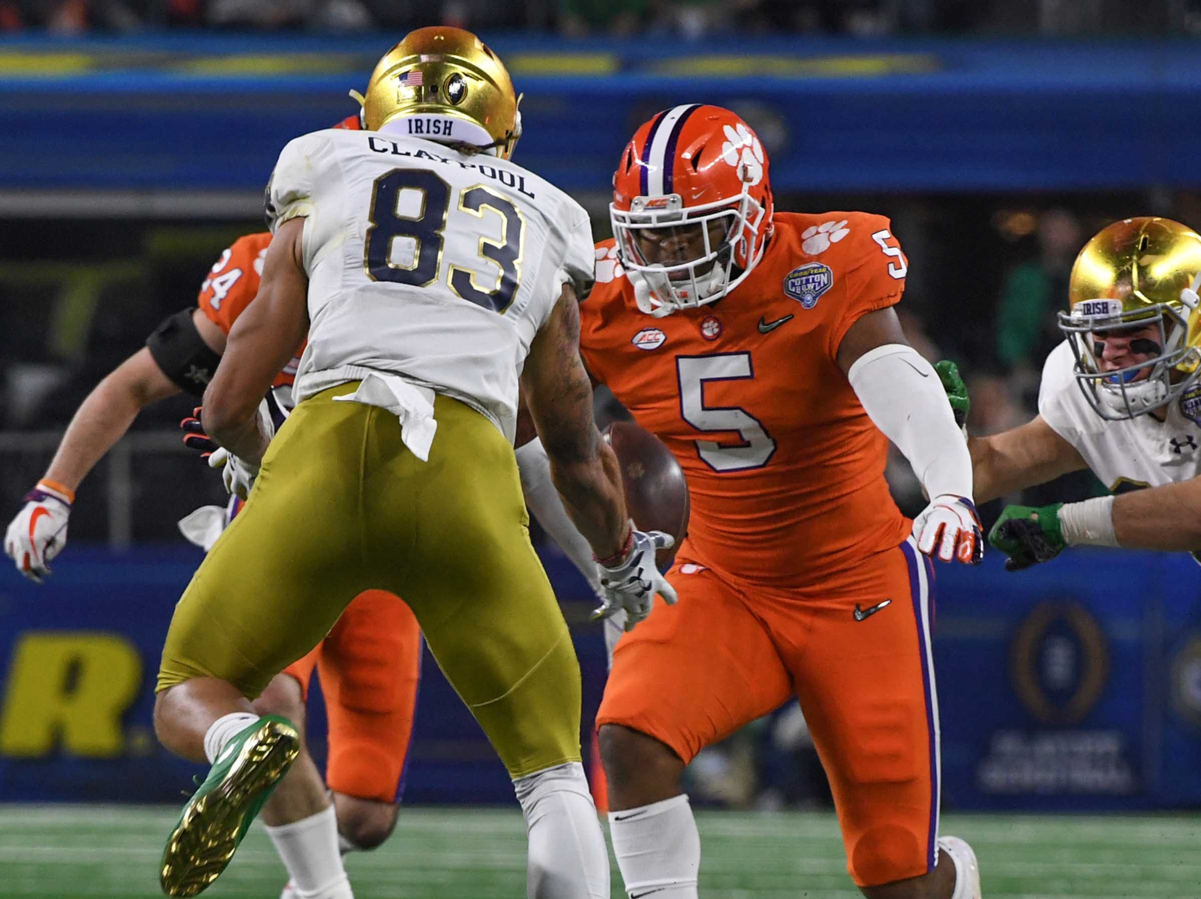 Clemson linebacker Shaq Smith (5) runs to tackle Notre Dame wide receiver Chase Claypool (83) during the third quarter of the College Football Playoff Semifinal at the Goodyear Cotton Bowl Classic at AT&T Stadium in Arlington, Texas Saturday, December 29, 2018.