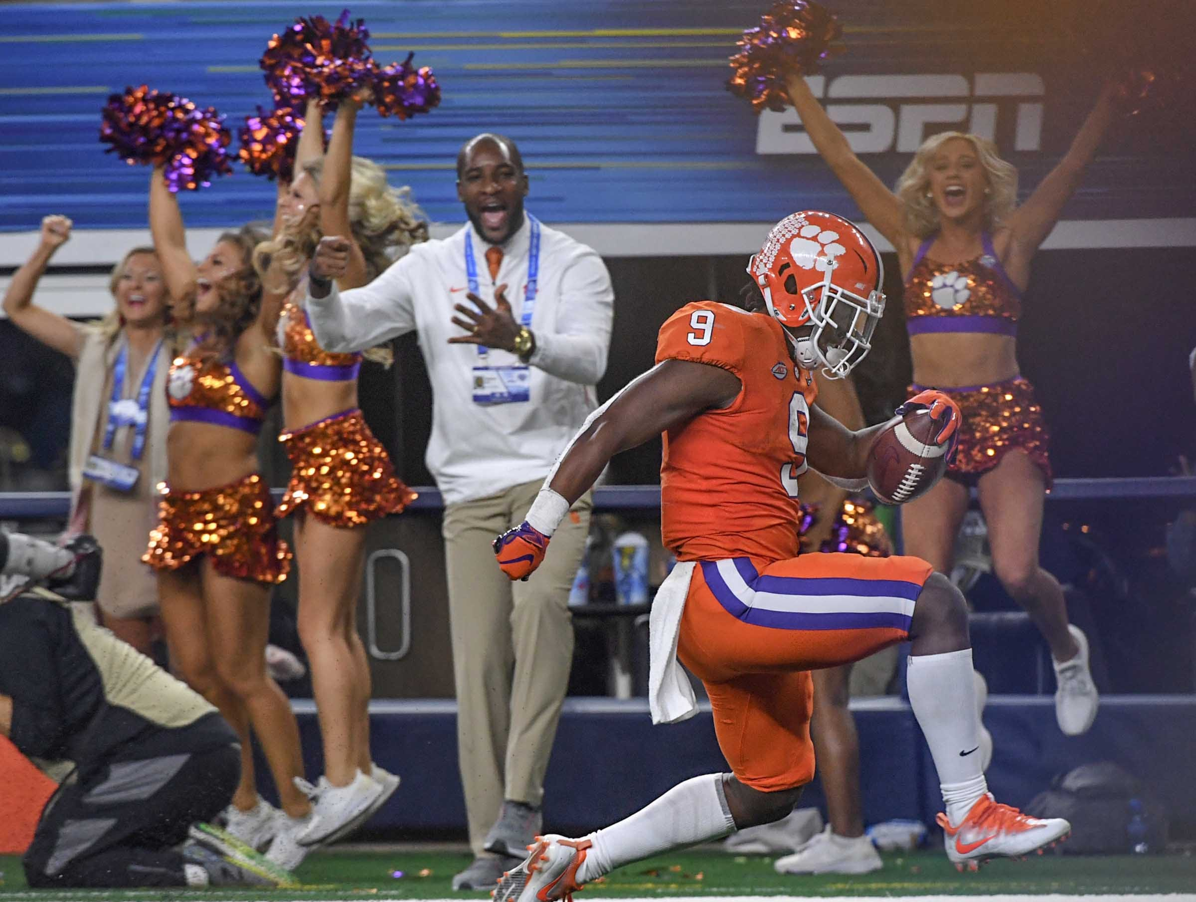 Clemson running back Travis Etienne (9) runs by Notre Dame safety Jalen Elliott (21) for a 61-yard touchdown  during the third quarter of the College Football Playoff Semifinal at the Goodyear Cotton Bowl Classic at AT&T Stadium in Arlington, Texas Saturday, December 29, 2018.