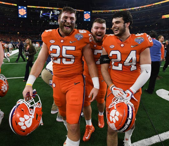 Clemson tight end J.C. Chalk (25), linebacker James Skalski (47), and safety Nolan Turner (24) after the Tigers 30-3 win over Notre Dame in the Goodyear Cotton Bowl at AT&T stadium in Arlington, TX Saturday, December 29, 2018.