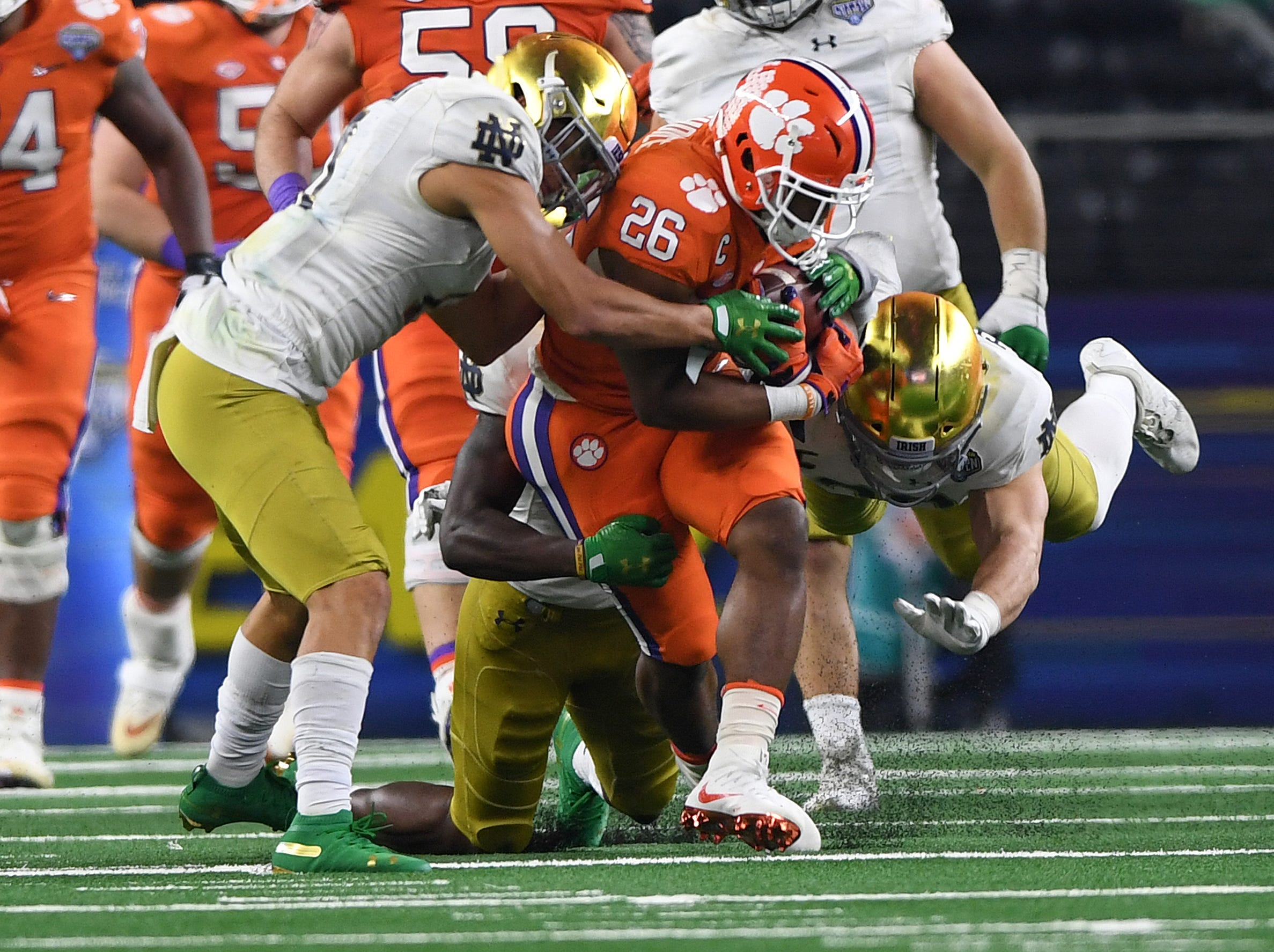 Clemson running back Adam Choice (26) carries against Notre Dame during the 4th quarter of the Goodyear Cotton Bowl at AT&T stadium in Arlington, TX Saturday, December 29, 2018.