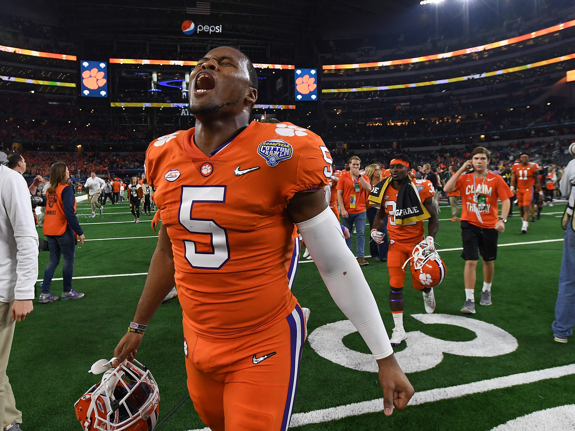 Clemson linebacker Shaq Smith (5) celebrates the Tigers 30-3 win over Notre Dame at AT&T stadium in Arlington, TX Saturday, December 29, 2018.