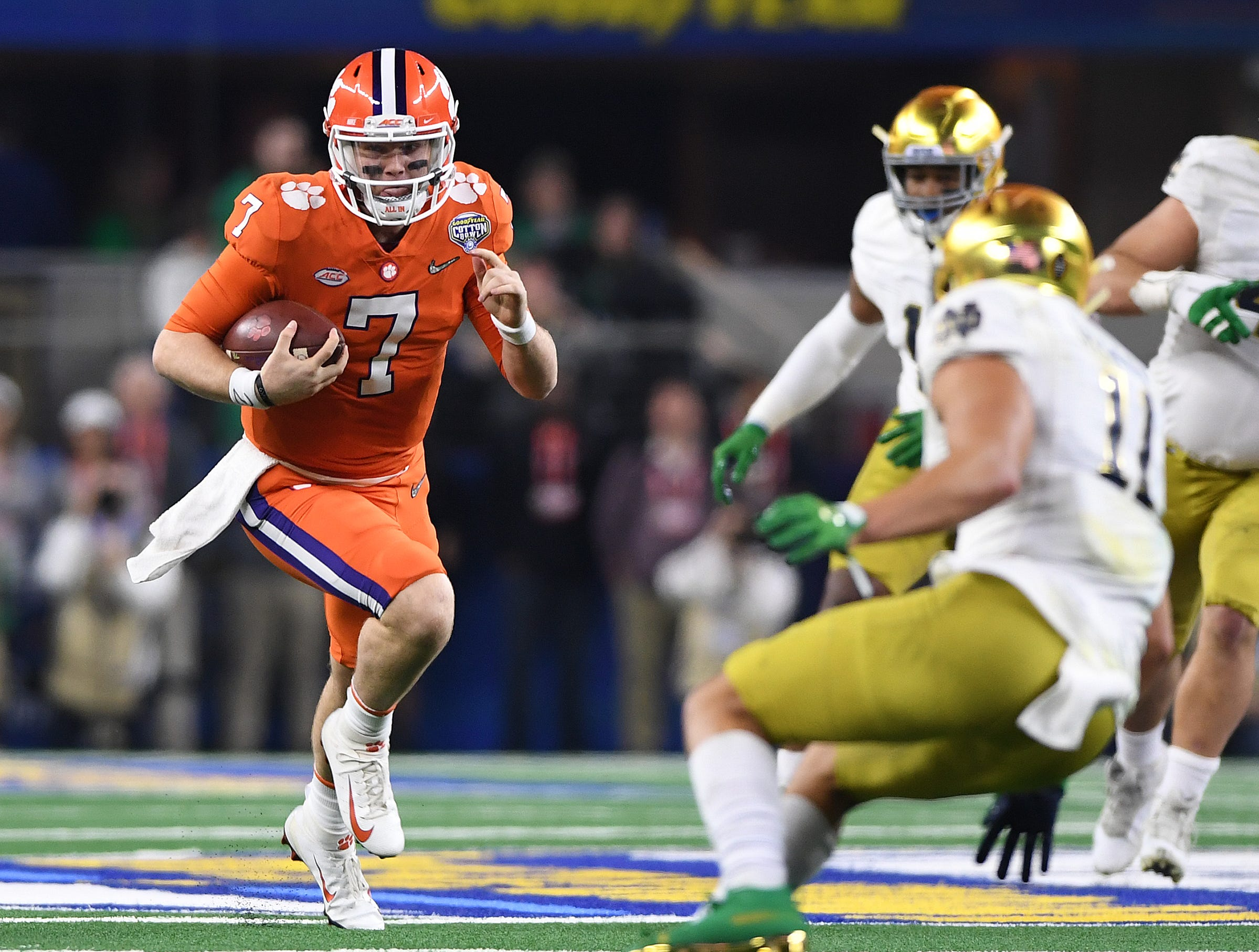Clemson quarterback Chase Brice (7) carries against Notre Dame during the 4th quarter of the Goodyear Cotton Bowl at AT&T stadium in Arlington, TX Saturday, December 29, 2018.