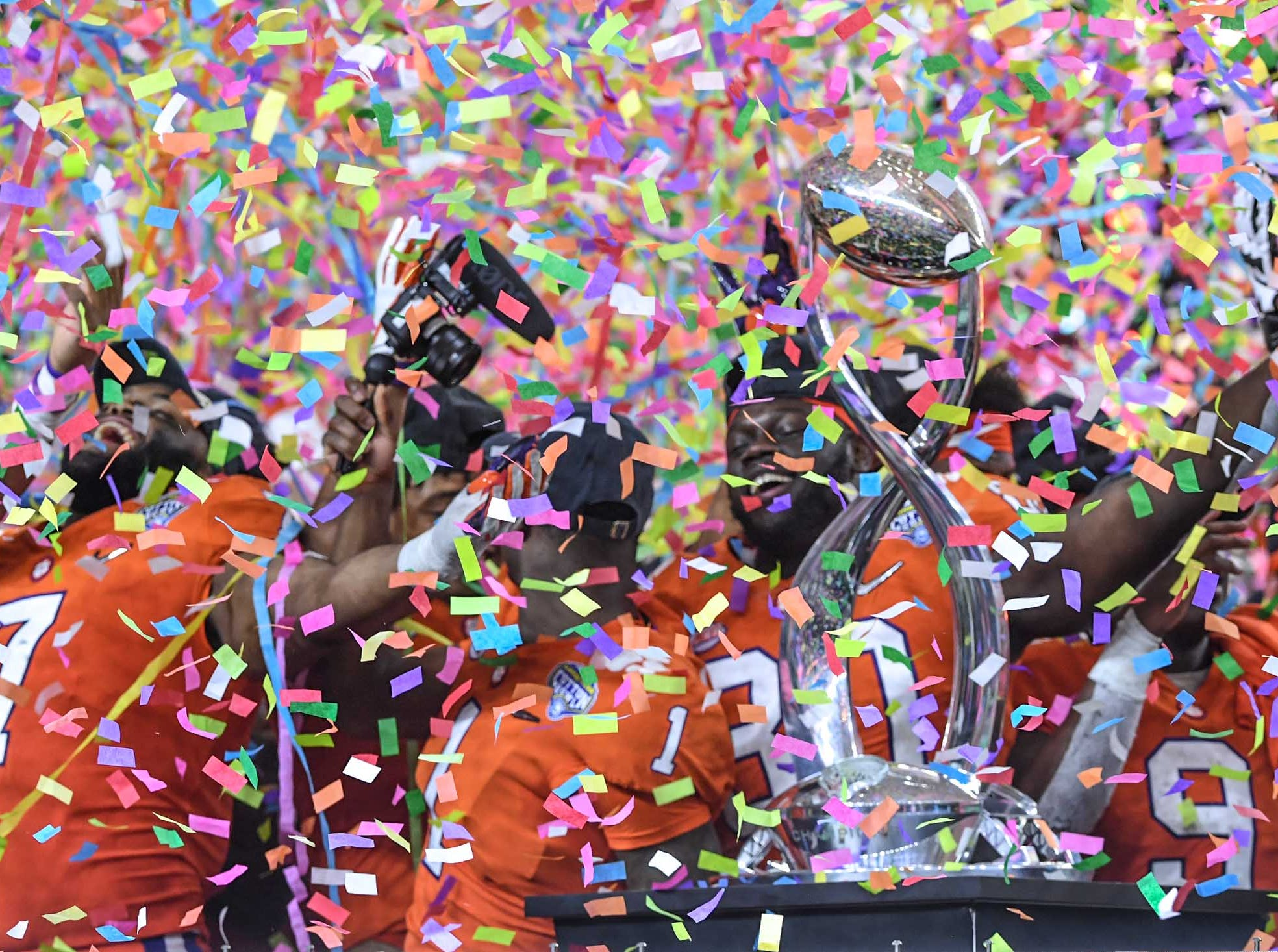 Clemson players are showered with confetti after their 30-3 win over Notre Dame in the College Football Playoff Semifinal at the Goodyear Cotton Bowl Classic at AT&T Stadium in Arlington, Texas Saturday, December 29, 2018.