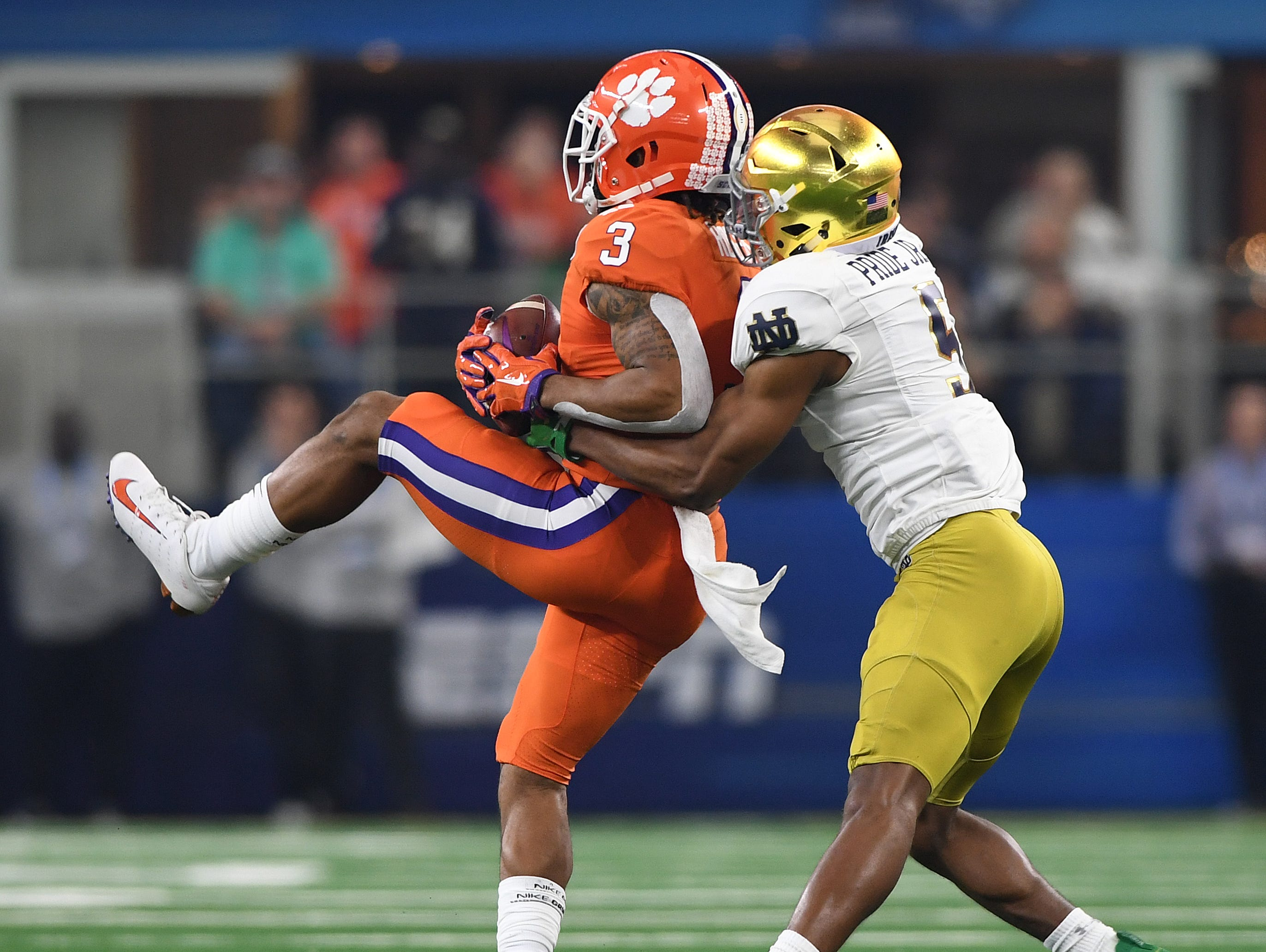 Clemson wide receiver Amari Rodgers (3) catches a pass past Notre Dame cornerback Troy Pride Jr. (5) during the 1st quarter of the Goodyear Cotton Bowl at AT&T stadium in Arlington, TX Saturday, December 29, 2018.