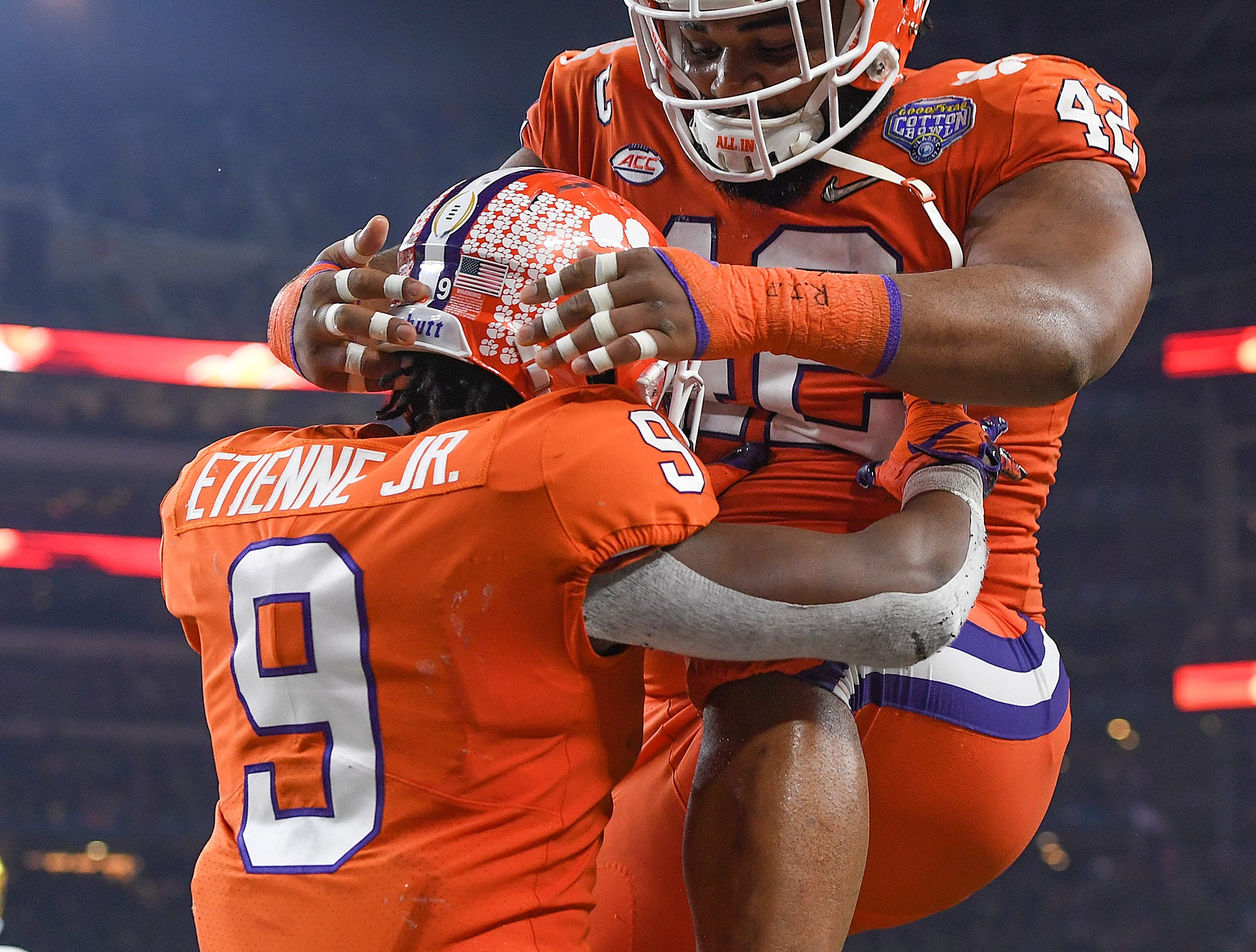 Clemson running back Travis Etienne (9) celebrates with defensive lineman Christian Wilkins (42) after scoring on a 62 yard TD carry against Notre Dame during the 3rd quarter of the Goodyear Cotton Bowl at AT&T stadium in Arlington, TX Saturday, December 29, 2018.