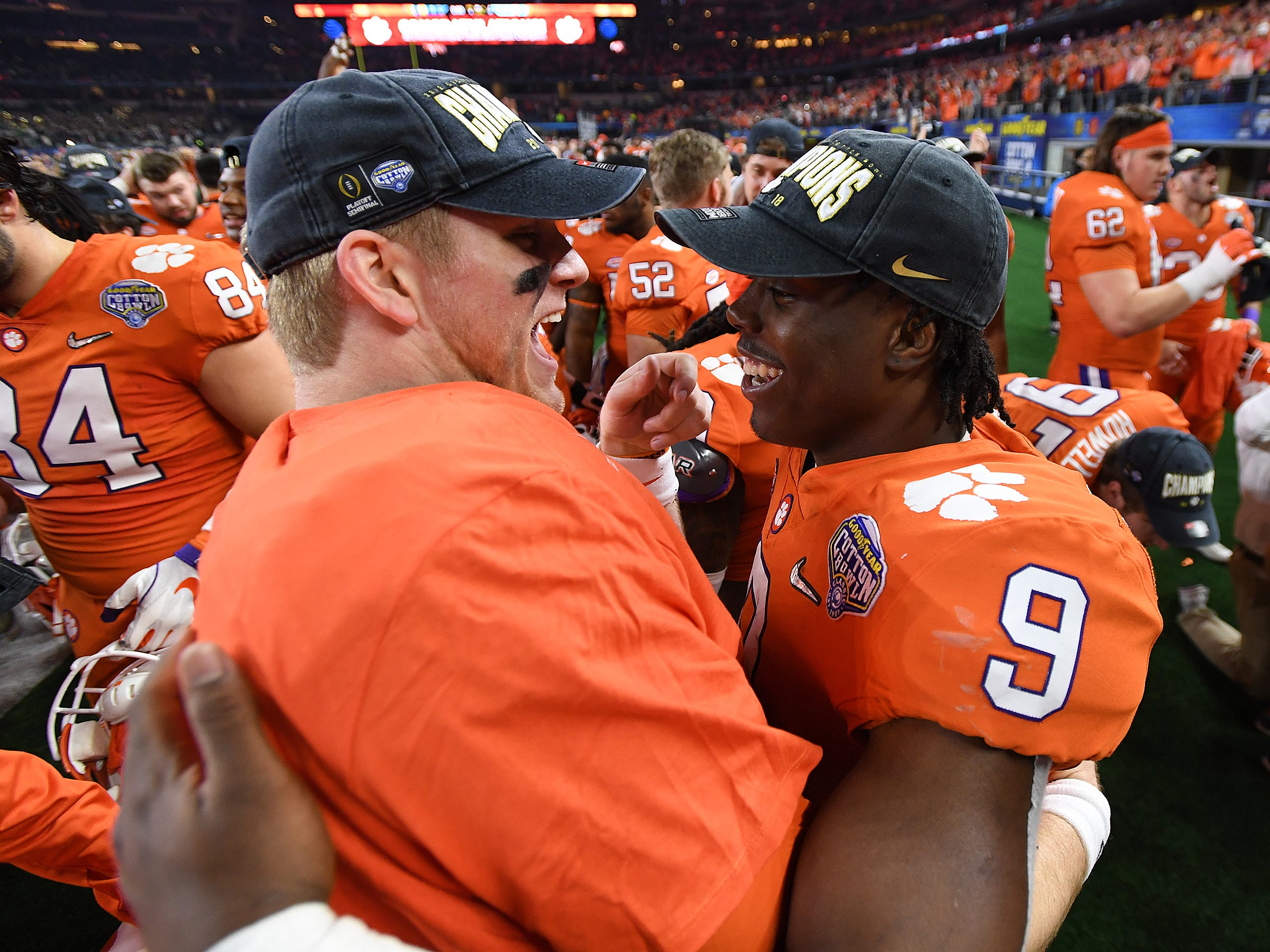 Clemson quarterback Chase Brice (7), left, hugs running back Travis Etienne (9) after the Tigers 30-3 win over Notre Dame at AT&T stadium in Arlington, TX Saturday, December 29, 2018.