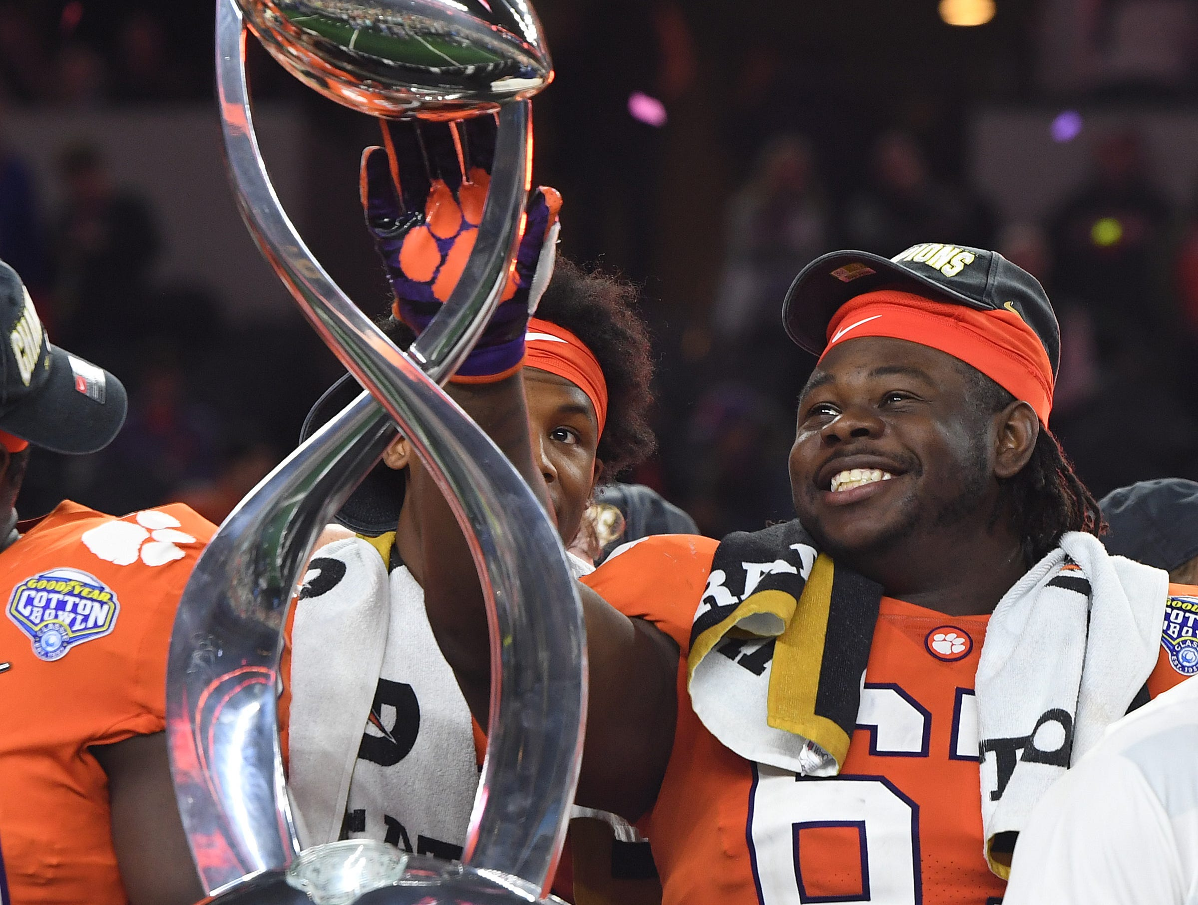 Clemson defensive lineman Albert Huggins (67) touches theGoodyear Cotton Bowl trophy after the Tigers 30-3 win over Notre Dame at AT&T stadium in Arlington, TX Saturday, December 29, 2018.