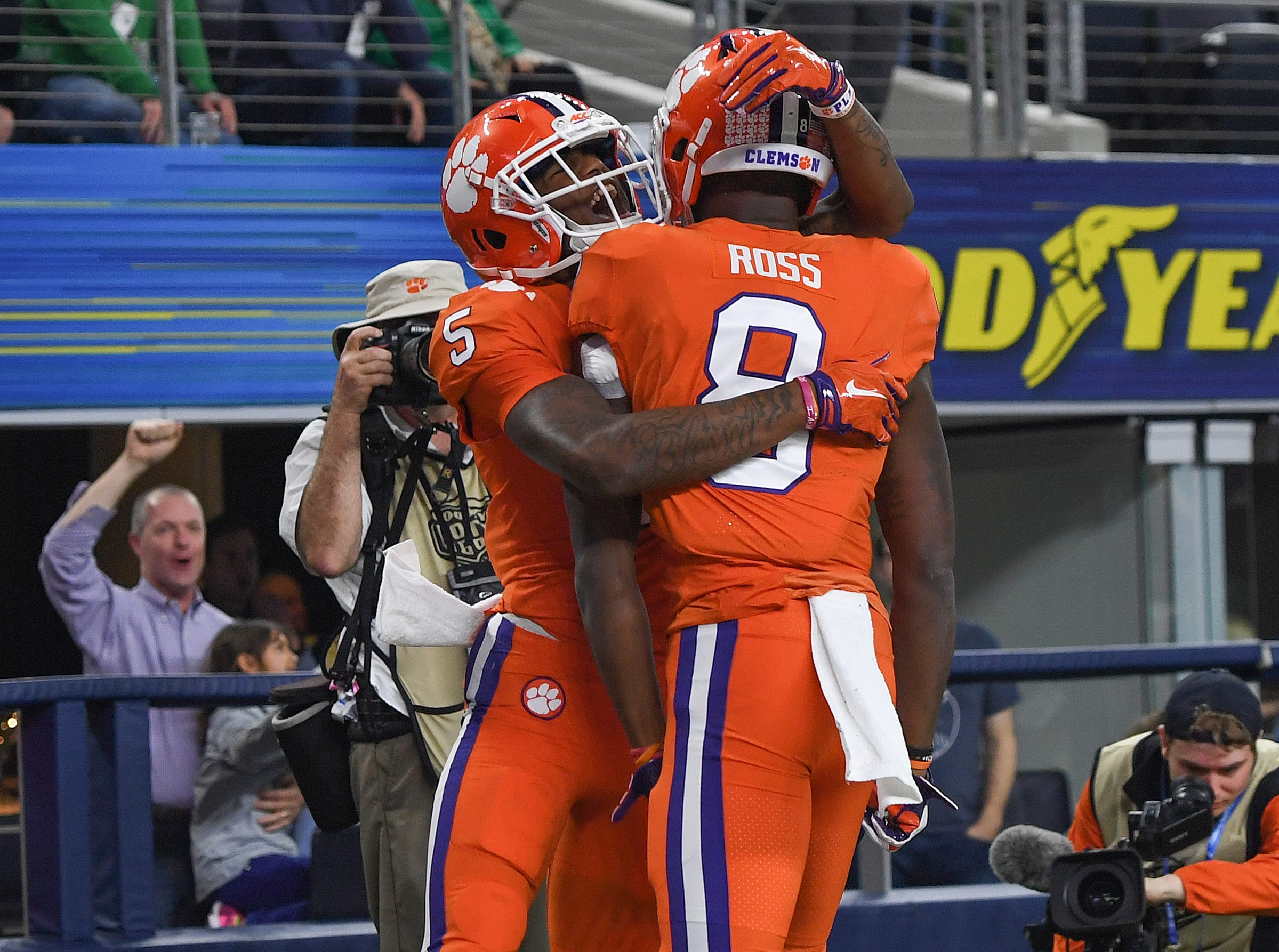 Clemson wide receiver Tee Higgins (5) hugs wide receiver Justyn Ross (8) after Ross caught a TD against Notre Dame during the 2nd quarter of the Goodyear Cotton Bowl at AT&T stadium in Arlington, TX Saturday, December 29, 2018.