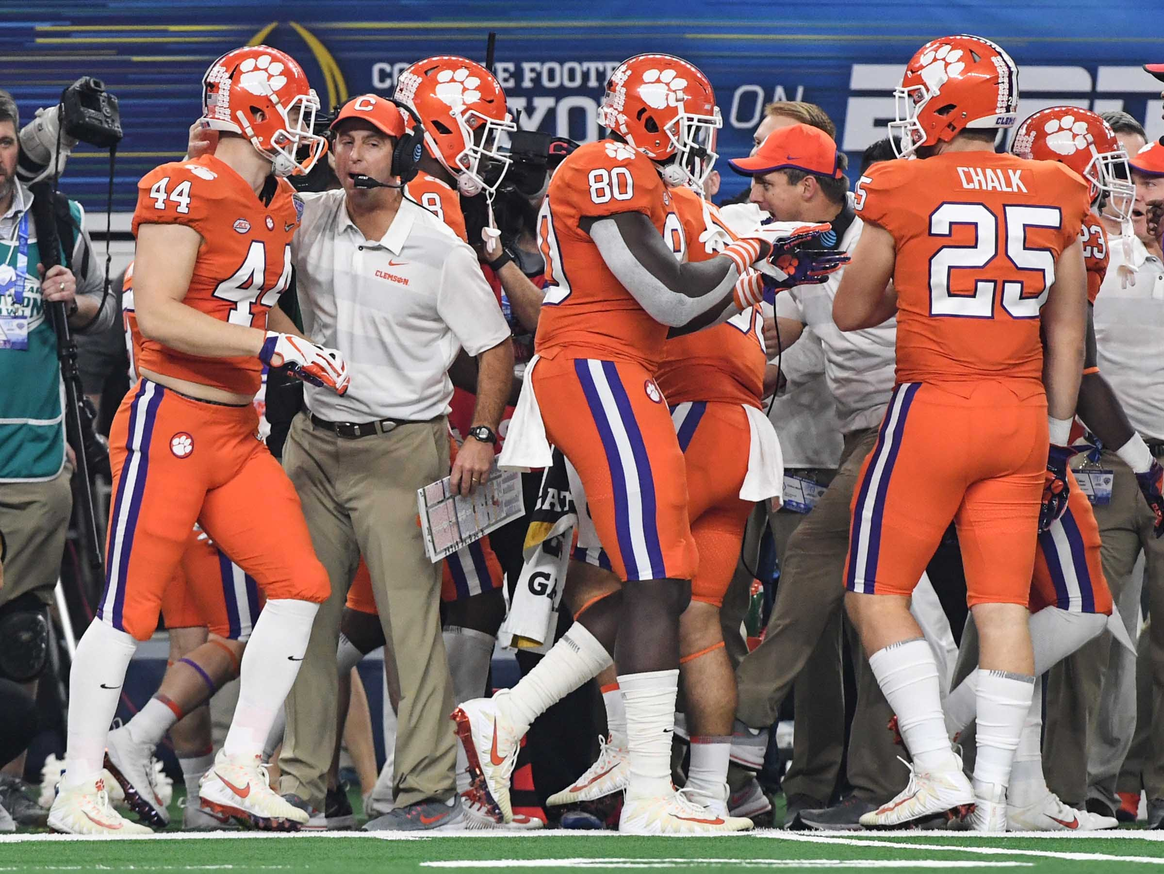 Clemson Head Coach Dabo Swinney watches tight end Garrett Williams (44) and tight end Milan Richard (80) come in after a play during the second quarter of the College Football Playoff Semifinal at the Goodyear Cotton Bowl Classic at AT&T Stadium in Arlington, Texas Saturday, December 29, 2018.