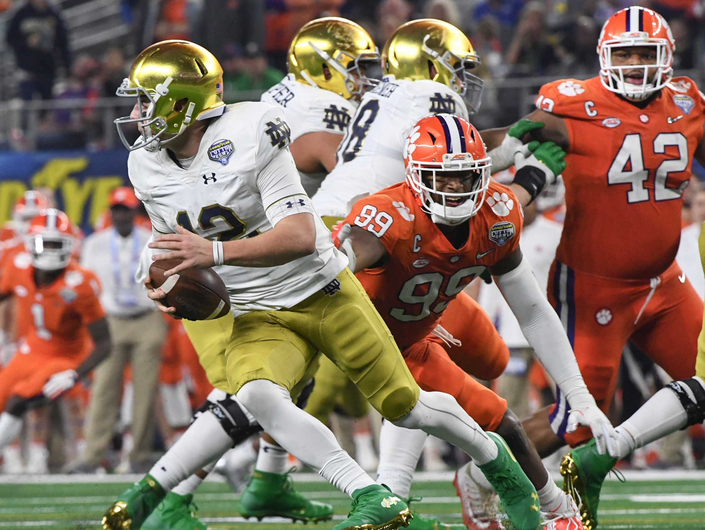 Clemson defensive lineman Clelin Ferrell (99) pressures Notre Dame quarterback Ian Book (12) during the fourth quarter of the College Football Playoff Semifinal at the Goodyear Cotton Bowl Classic at AT&T Stadium in Arlington, Texas Saturday, December 29, 2018.