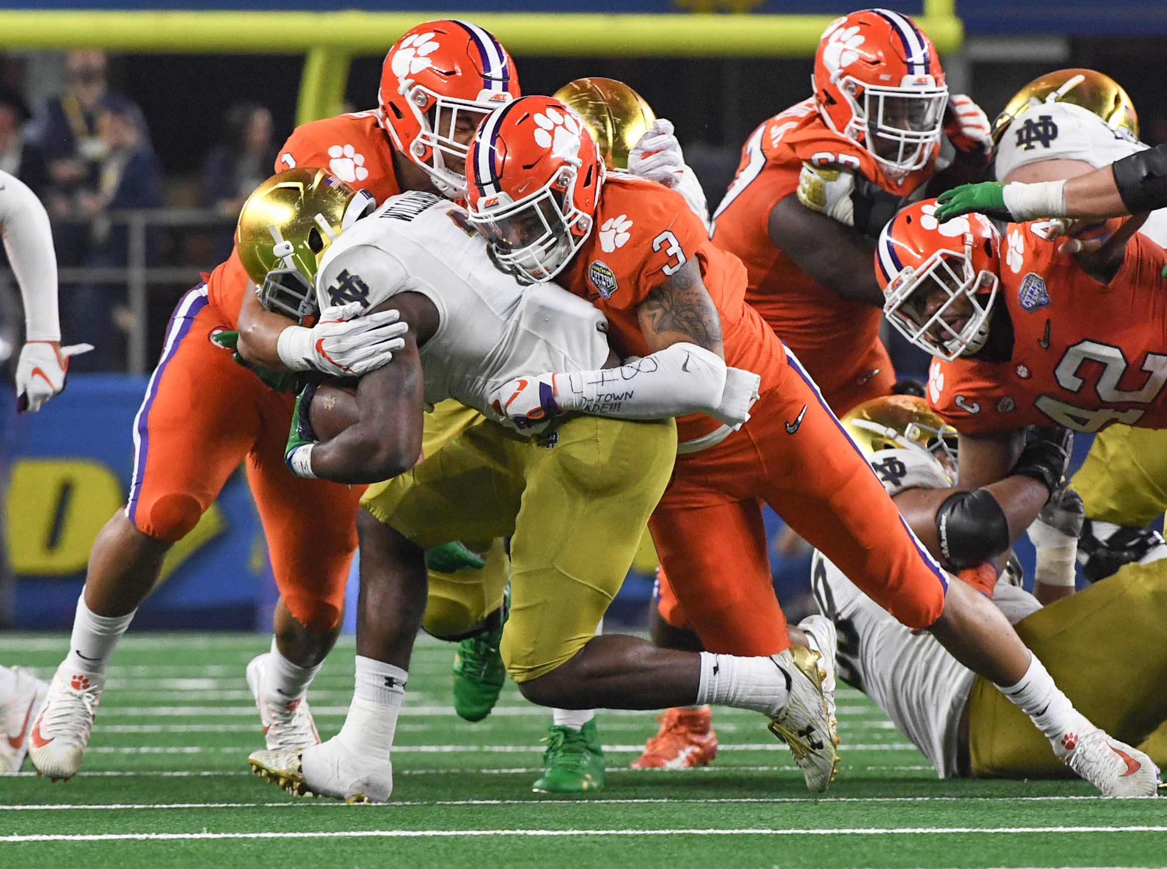 Clemson defensive lineman Xavier Thomas (3) tackles Notre Dame running back Dexter Williams (2) during the third quarter of the College Football Playoff Semifinal at the Goodyear Cotton Bowl Classic at AT&T Stadium in Arlington, Texas Saturday, December 29, 2018.