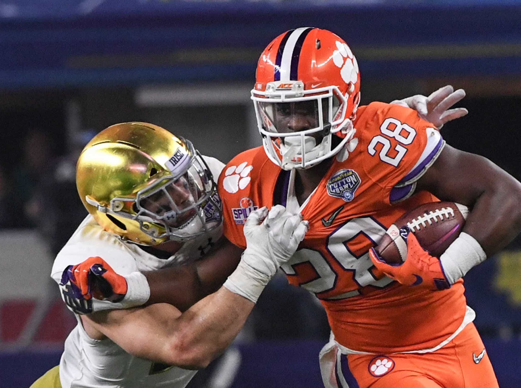 Clemson running back Tavien Feaster (28) runs against Notre Dame during the fourth quarter of the College Football Playoff Semifinal at the Goodyear Cotton Bowl Classic at AT&T Stadium in Arlington, Texas Saturday, December 29, 2018.