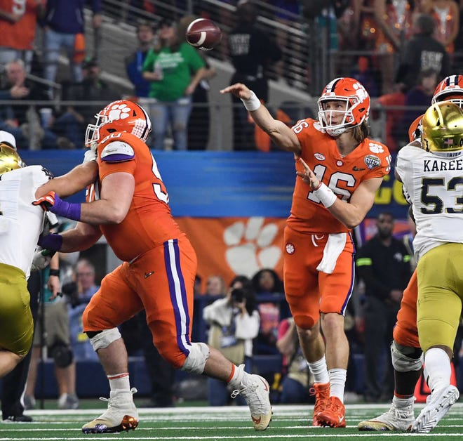 Clemson quarterback Trevor Lawrence (16) passes against Notre Dame during the third quarter of the College Football Playoff Semifinal at the Goodyear Cotton Bowl Classic at AT&T Stadium in Arlington, Texas Saturday, December 29, 2018.