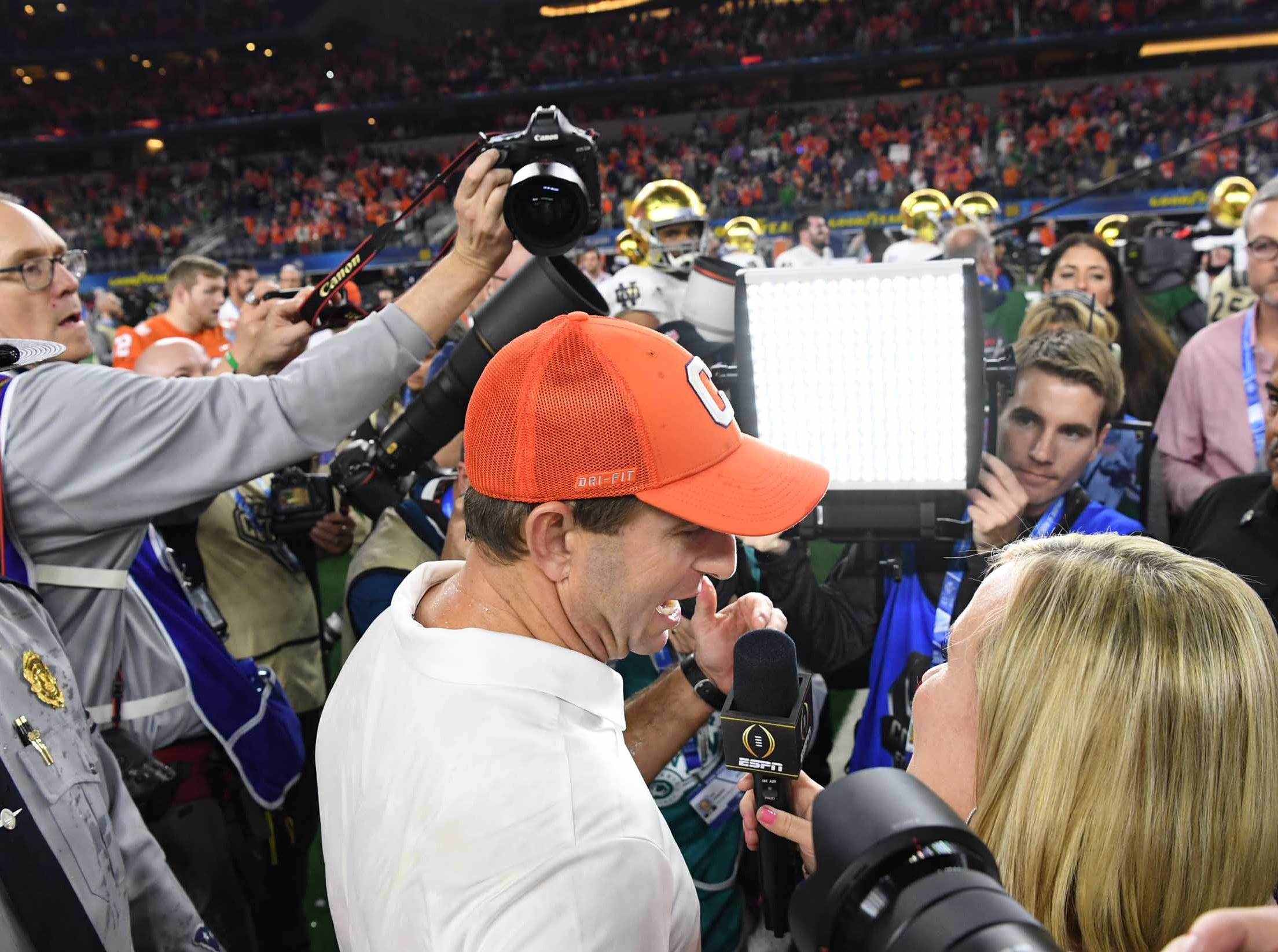 Clemson Head Coach Dabo Swinney talks with ESPN after the College Football Playoff Semifinal 30-3 win over Notre Dame at the Goodyear Cotton Bowl Classic at AT&T Stadium in Arlington, Texas Saturday, December 29, 2018.