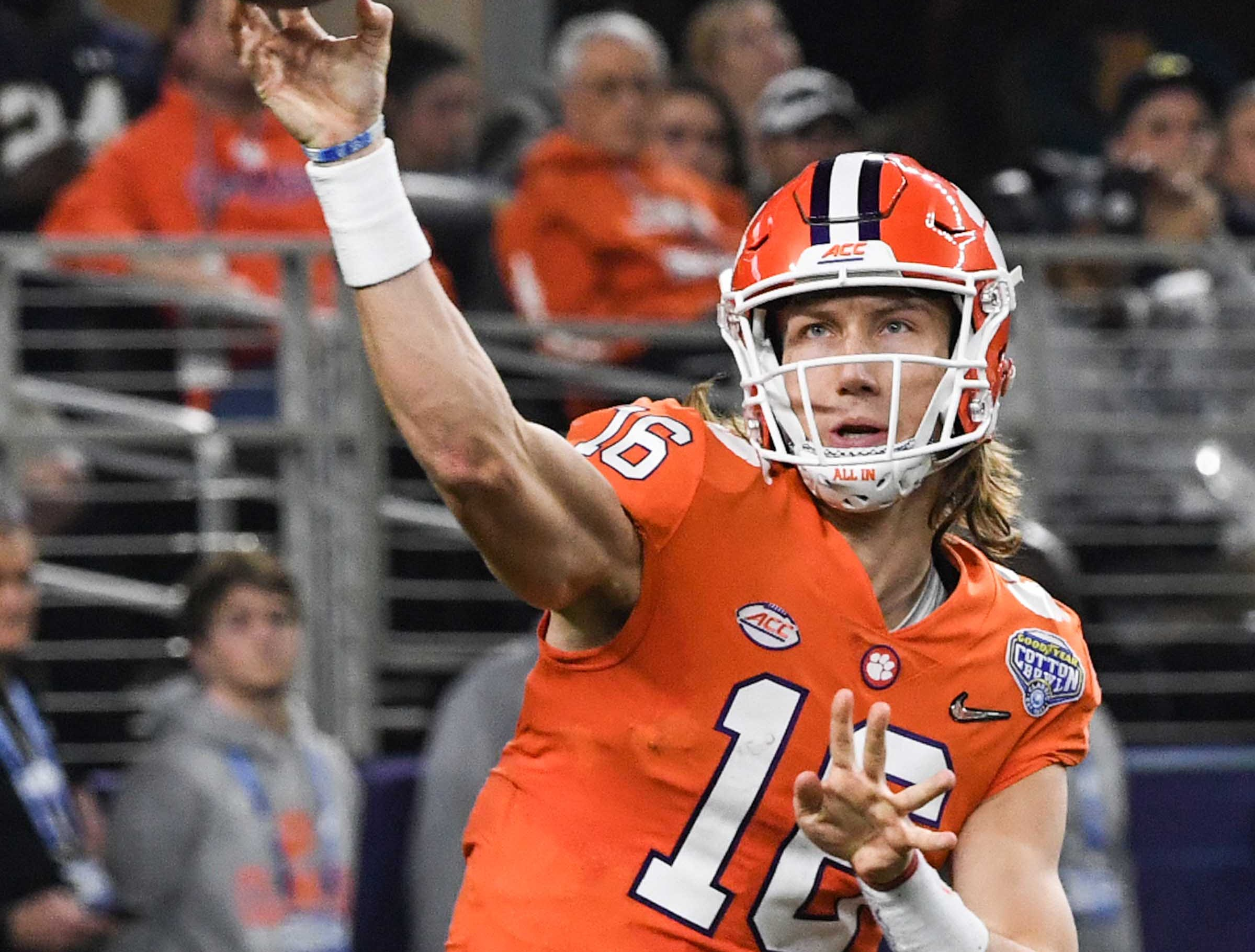Clemson quarterback Trevor Lawrence (16) throws against Notre Dame during the third quarter of the College Football Playoff Semifinal at the Goodyear Cotton Bowl Classic at AT&T Stadium in Arlington, Texas Saturday, December 29, 2018.