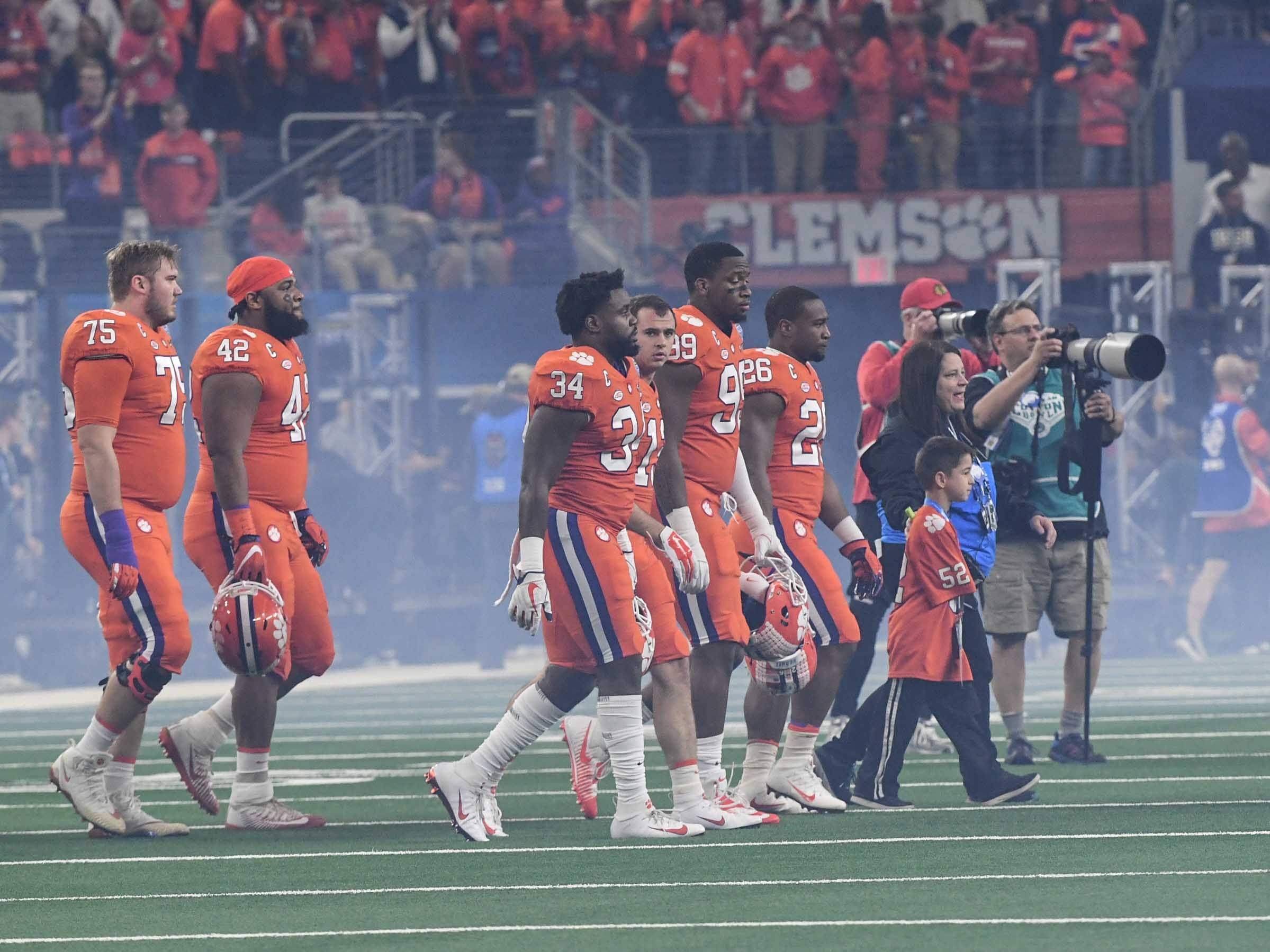 Clemson players walk out for the coin toss before the first quarter of the College Football Playoff Semifinal at the Goodyear Cotton Bowl Classic at AT&T Stadium in Arlington, Texas Saturday, December 29, 2018.