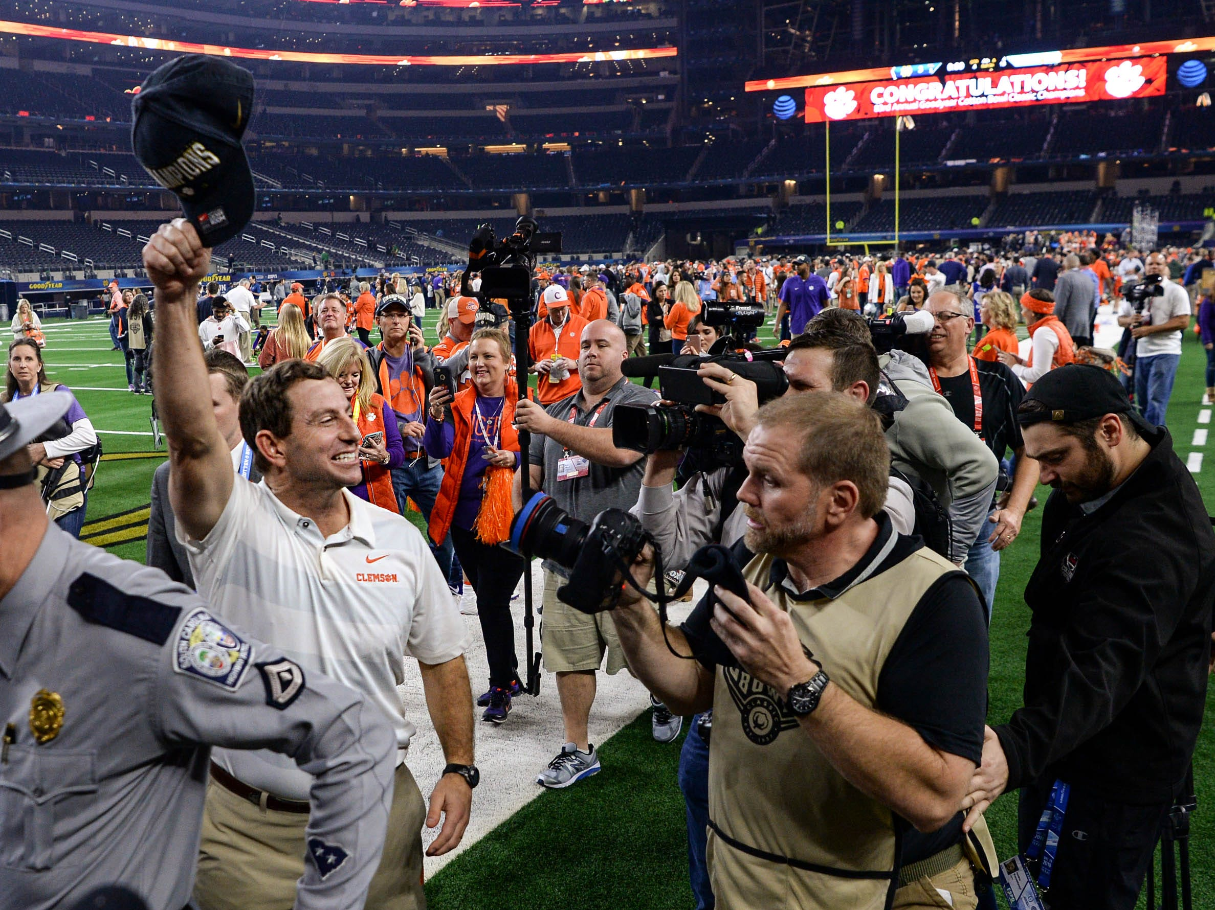Clemson Head Coach Dabo Swinney waves to fans after the College Football Playoff Semifinal 30-3 win over Notre Dame at the Goodyear Cotton Bowl Classic at AT&T Stadium in Arlington, Texas Saturday, December 29, 2018.
