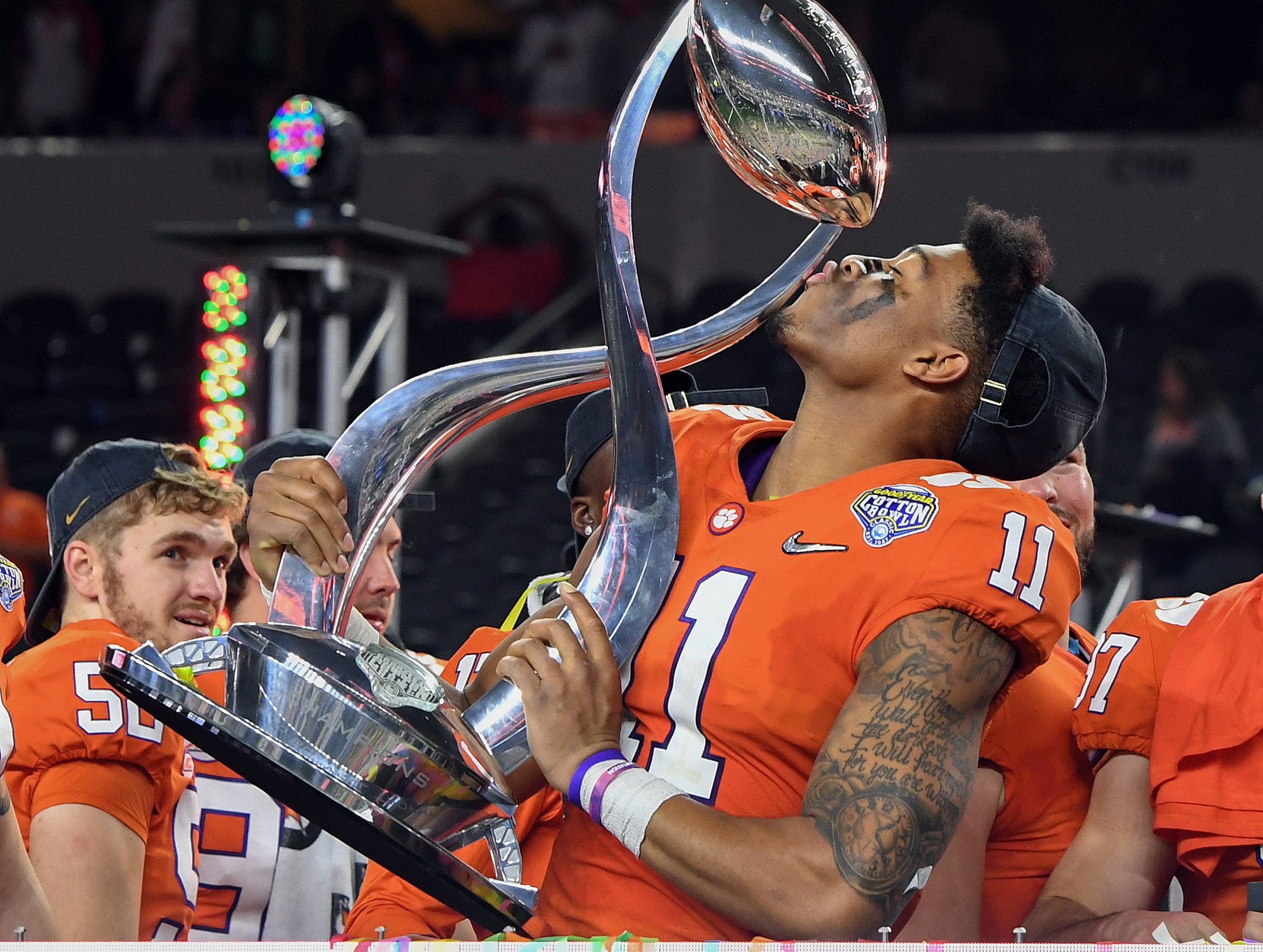 Clemson safety Isaiah Simmons (11) kisses the Goodyear Cotton Bowl trophy after the Tigers 30-3 win over Notre Dame at AT&T stadium in Arlington, TX Saturday, December 29, 2018.