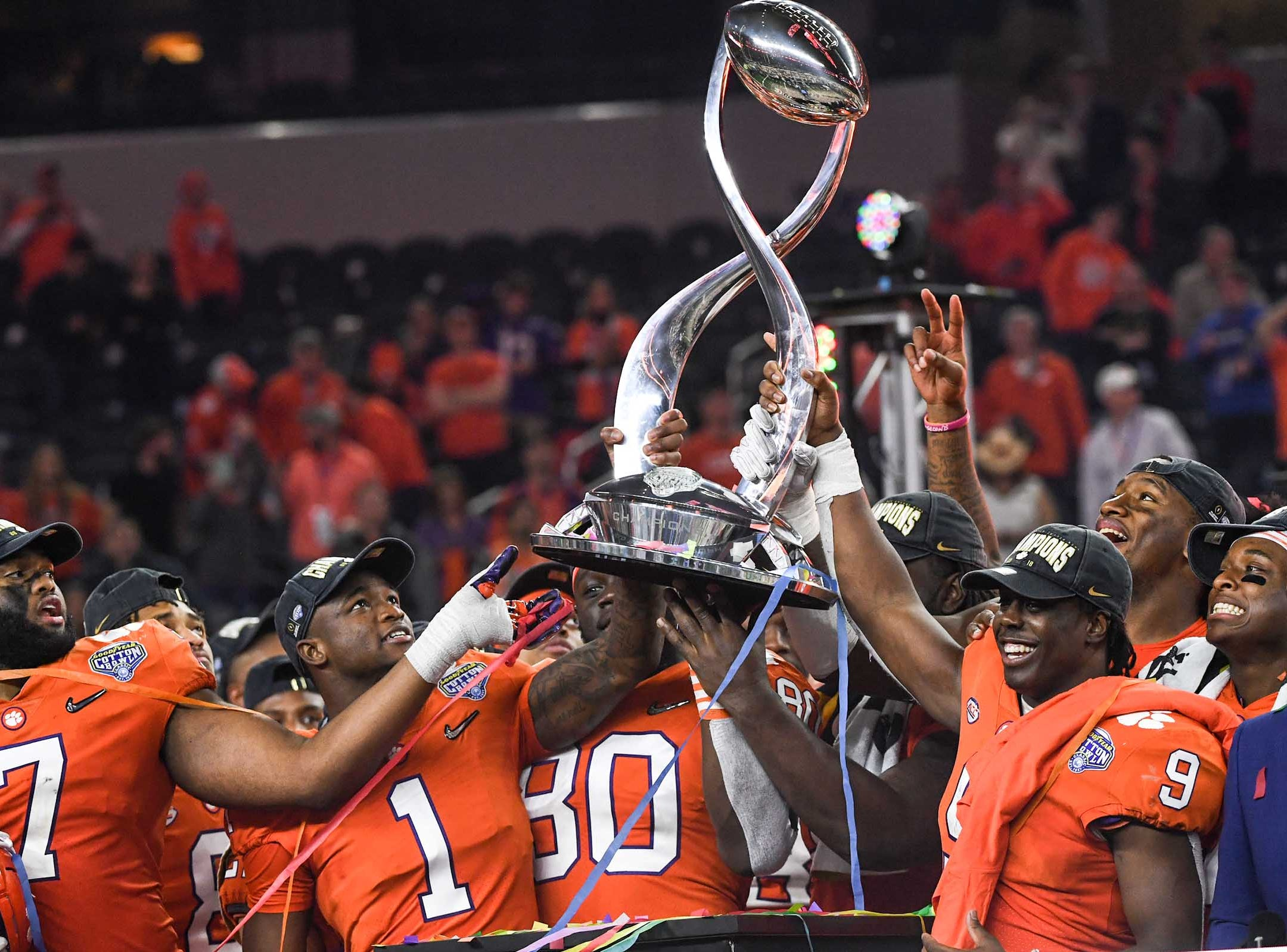Clemson defensive lineman Austin Bryant (7), left, cornerback Trayvon Mullen (1), tight end Milan Richard (80), running back Travis Etienne (9) and defensive lineman Clelin Ferrell (99) hold up the trophy after their 30-3 win over Notre Dame in the College Football Playoff Semifinal at the Goodyear Cotton Bowl Classic at AT&T Stadium in Arlington, Texas Saturday, December 29, 2018.