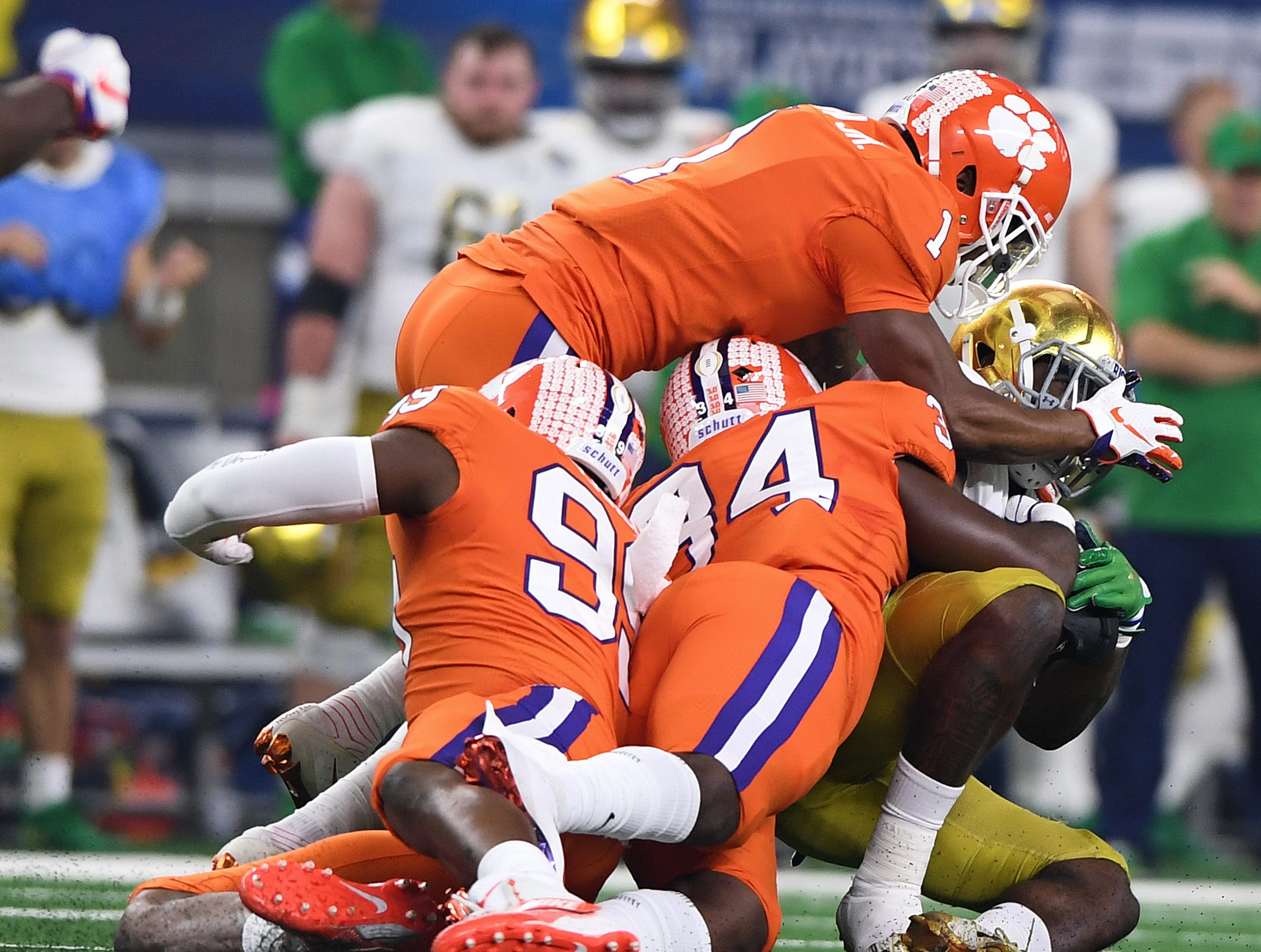 Clemson linebacker Kendall Joseph (34) and cornerback Trayvon Mullen (1) bring down Notre Dame running back Dexter Williams (2) during the 1st quarter of the Goodyear Cotton Bowl at AT&T stadium in Arlington, TX Saturday, December 29, 2018.