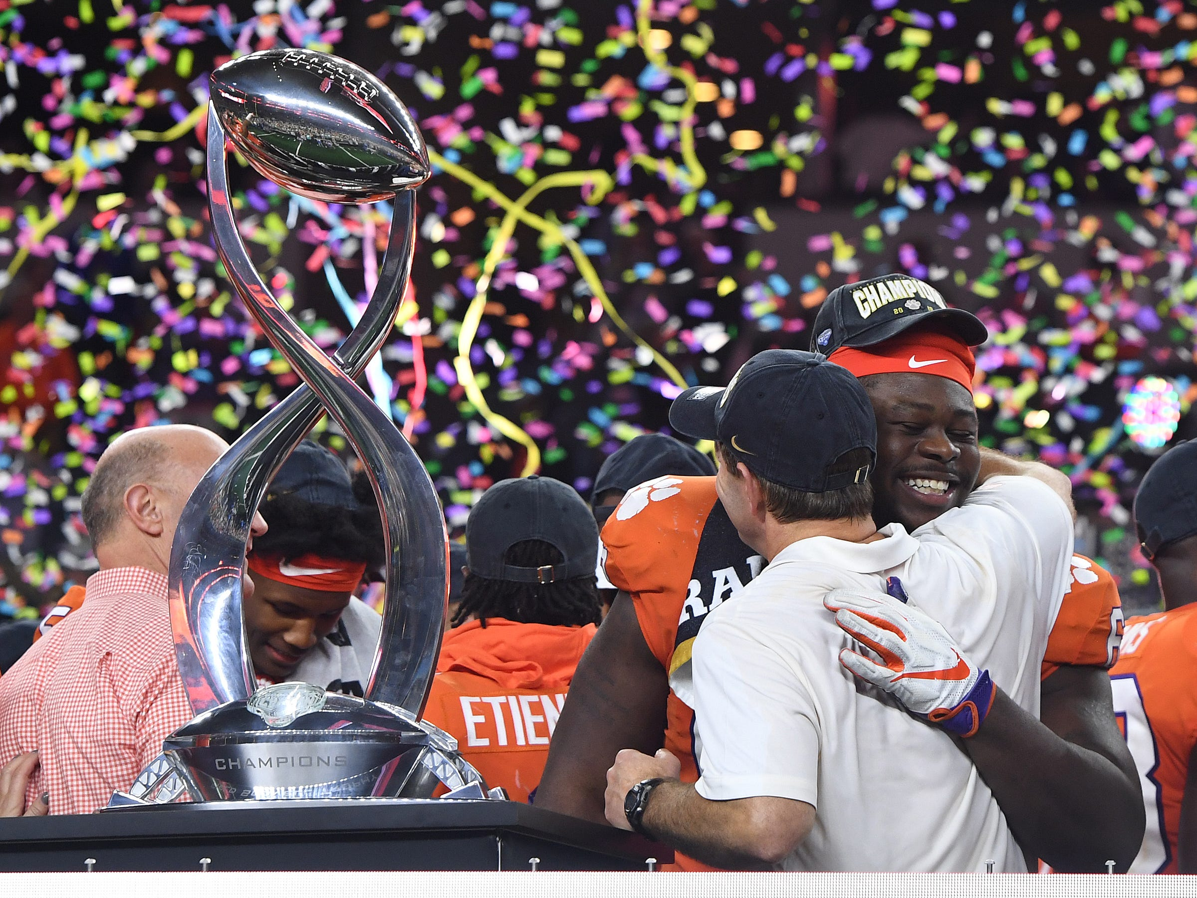 Clemson defensive lineman Albert Huggins (67) hugs head coach Dabo Swinney after the Tigers 30-3 win over Notre Dame in the Goodyear Cotton Bowl at AT&T stadium in Arlington, TX Saturday, December 29, 2018.