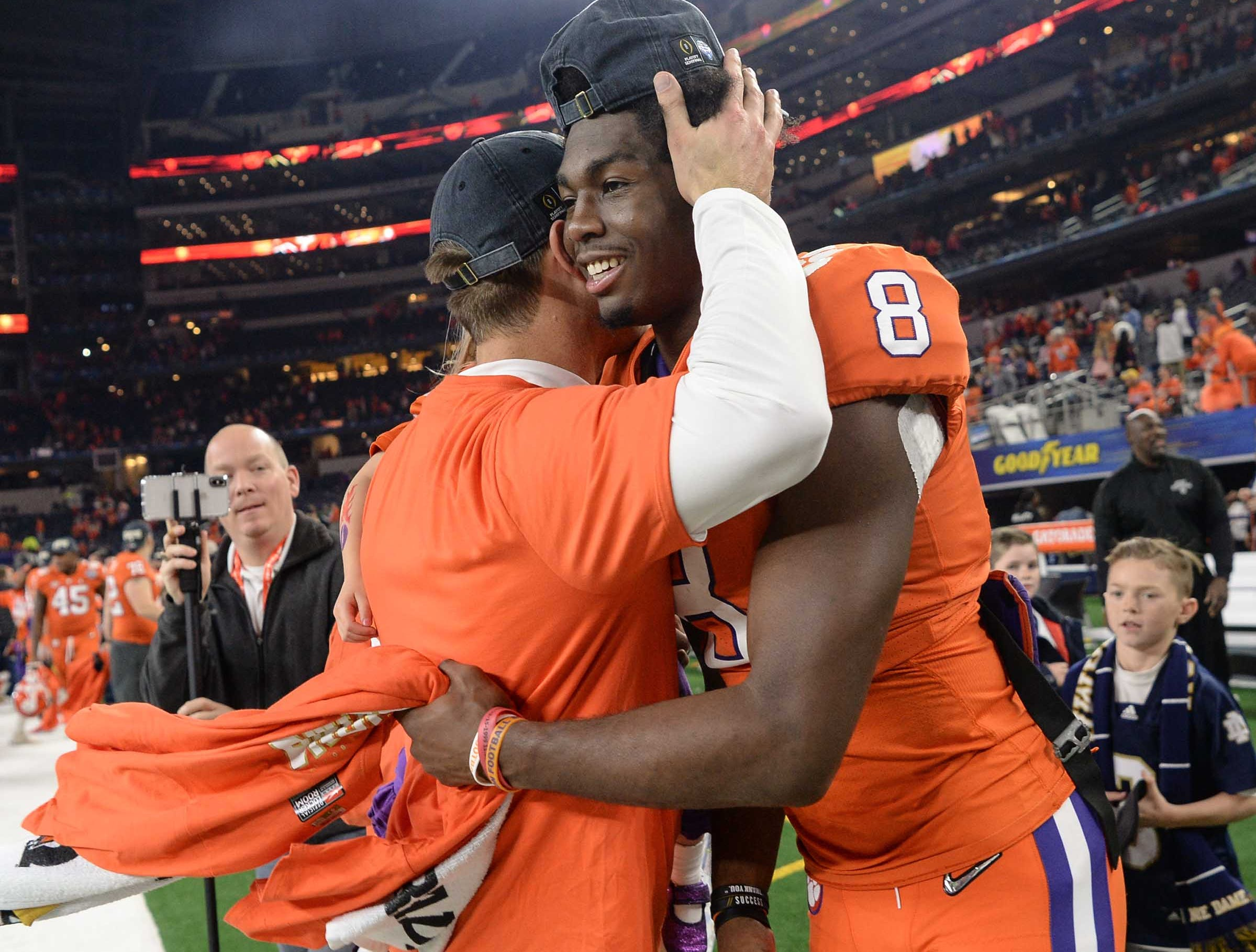 Clemson wide receiver coach Jeff Scott hugs wide receiver Justyn Ross (8) after the College Football Playoff Semifinal 30-3 win over Notre Dame at the Goodyear Cotton Bowl Classic at AT&T Stadium in Arlington, Texas Saturday, December 29, 2018.
