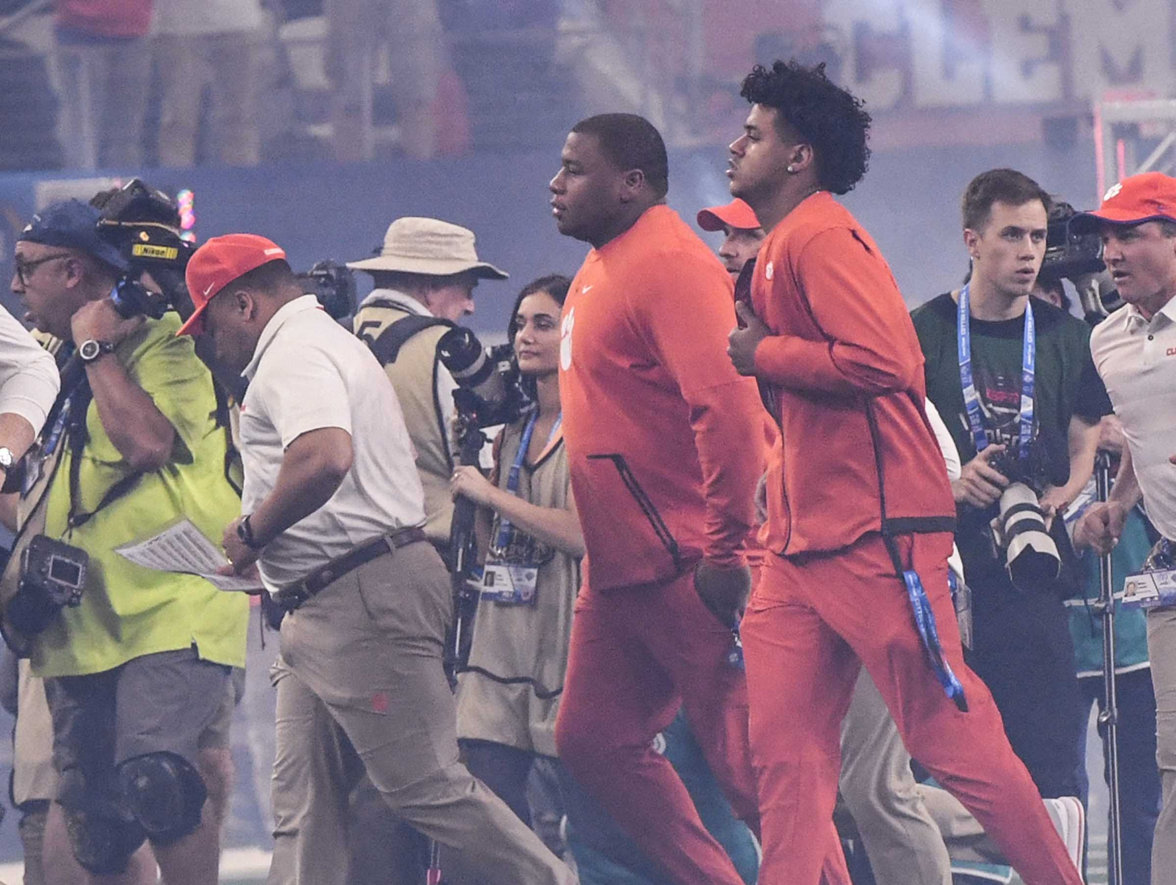 Clemson defensive lineman Dexter Lawrence, middle, and Braden Galloway run with players on the field before the first quarter of the College Football Playoff Semifinal at the Goodyear Cotton Bowl Classic at AT&T Stadium in Arlington, Texas Saturday, December 29, 2018.
