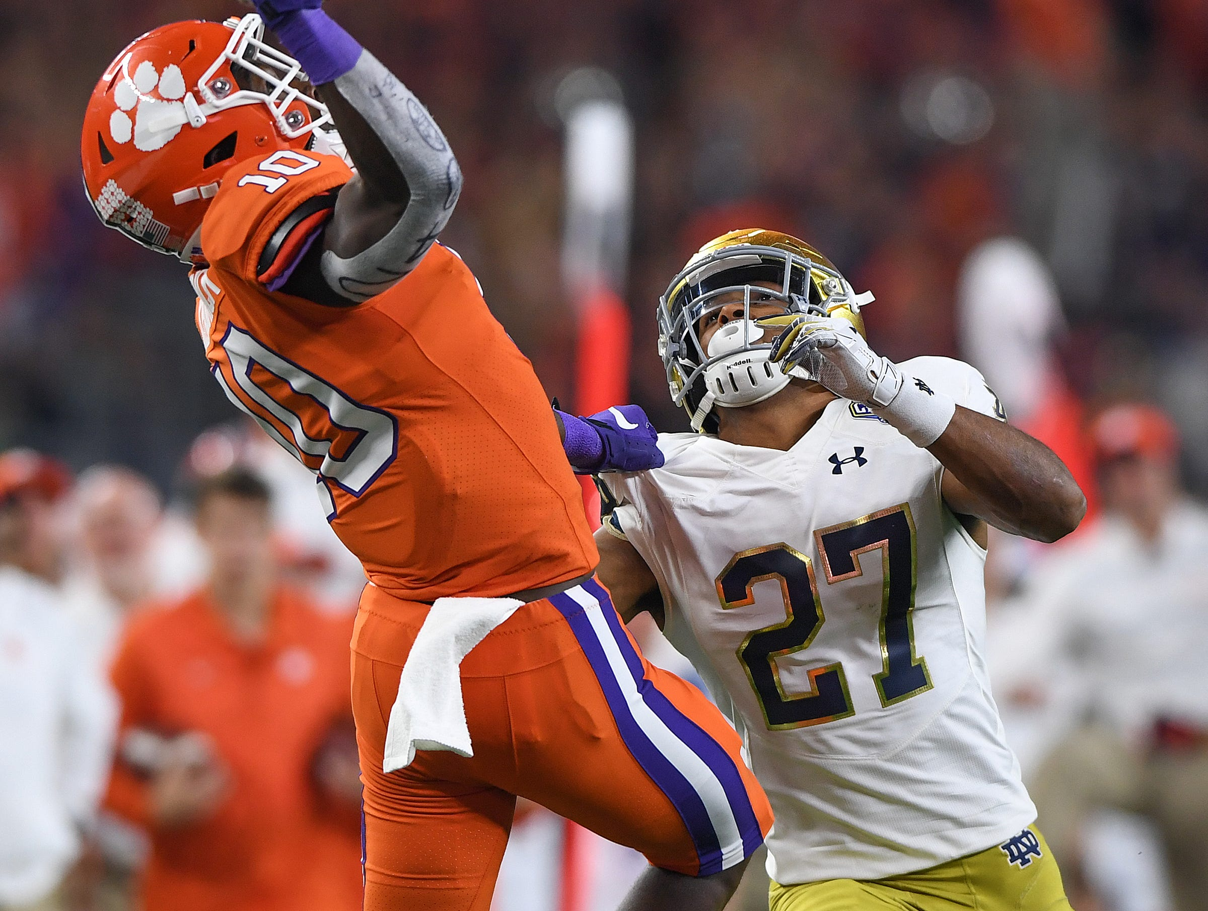 Clemson wide receiver Derion Kendrick (10) can't come down with a pass while being defended by Notre Dame cornerback Julian Love (27) during the 4th quarter of the Goodyear Cotton Bowl at AT&T stadium in Arlington, TX Saturday, December 29, 2018.