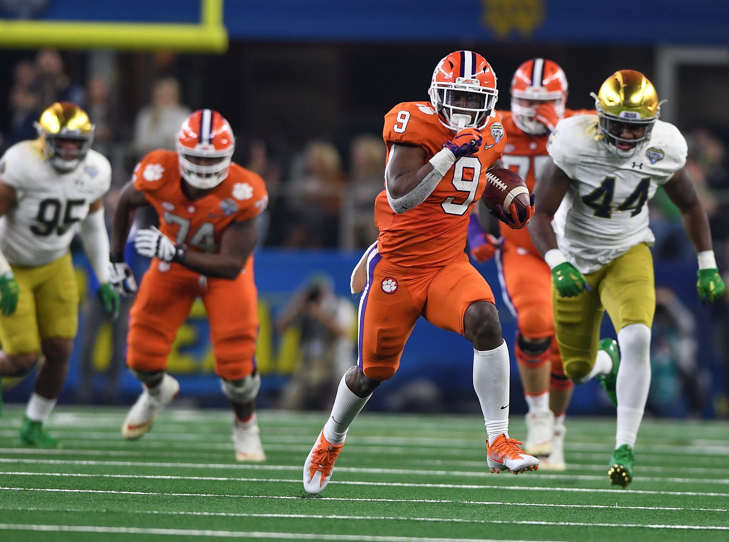 Clemson running back Travis Etienne (9) races 62 yards to score against Notre Dame during the 3rd quarter of the Goodyear Cotton Bowl at AT&T stadium in Arlington, TX Saturday, December 29, 2018.