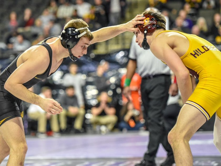 Iowa's Spencer Lee wrestles Central Michigan's Drew Hildebrandt in the quarterfinals of the 2018 Midlands Championships. Lee beat Hildebrandt, 18-0, on his way to the finals at 125 pounds.
