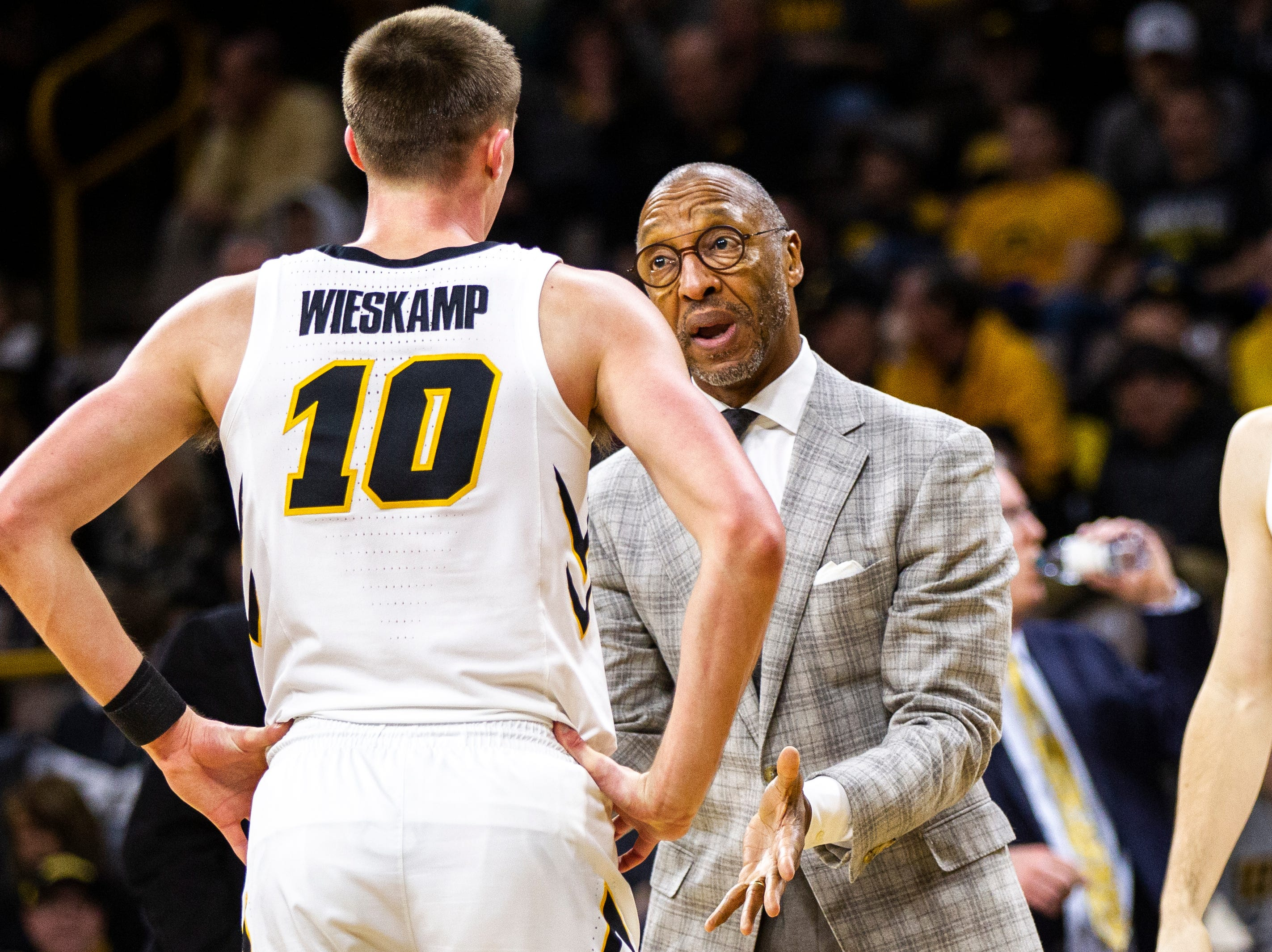Iowa guard Joe Wieskamp (10) talks with Iowa assistant Sherman Dillard during a NCAA men's basketball game on Saturday, Dec. 29, 2018, at Carver-Hawkeye Arena in Iowa City.